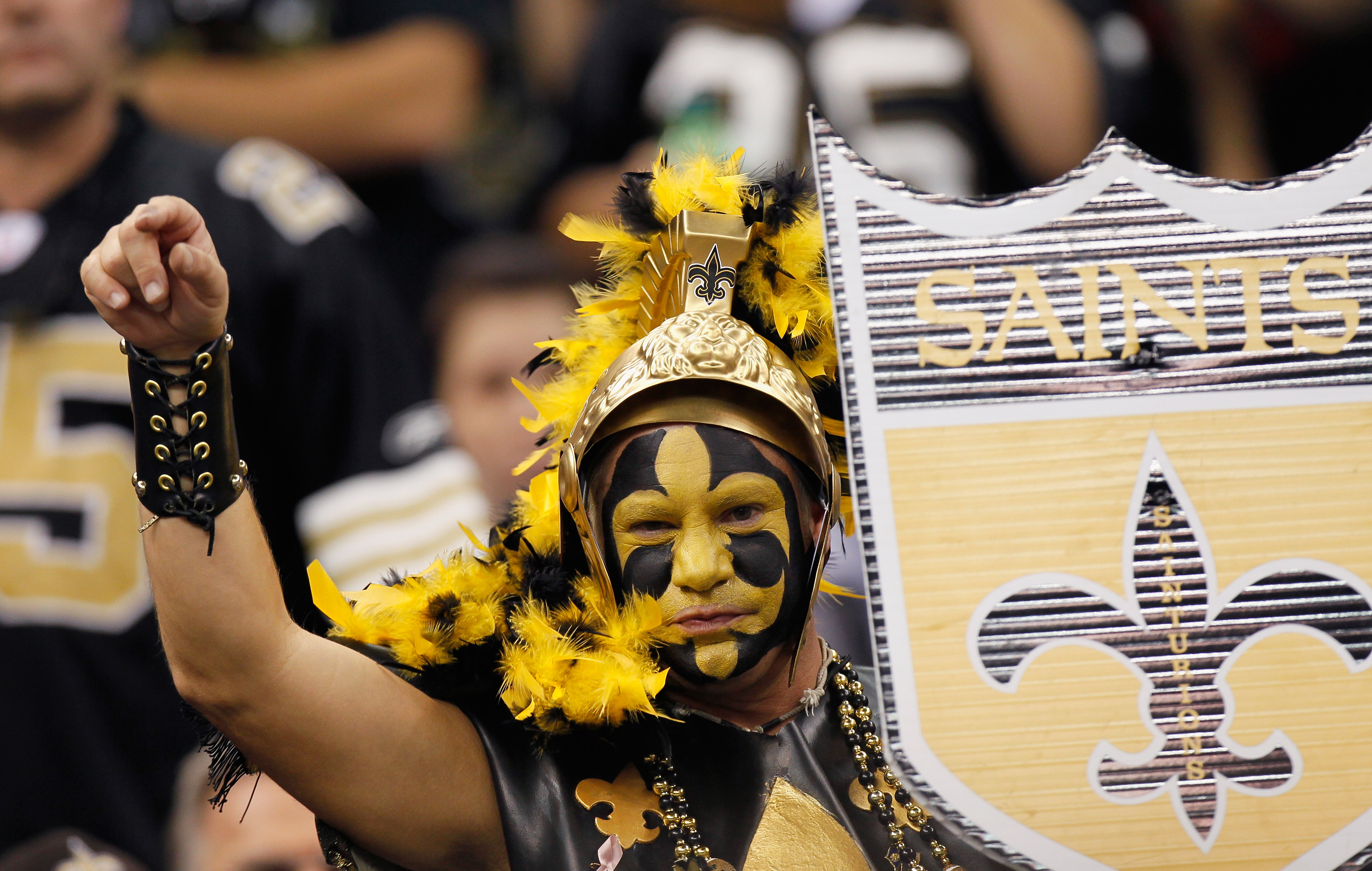 NEW ORLEANS - NOVEMBER 21:  A fan of the New Orleans Saints cheers against the Seattle Seahawks at Louisiana Superdome on November 21, 2010 in New Orleans, Louisiana.  (Photo by Kevin C. Cox/Getty Images)
