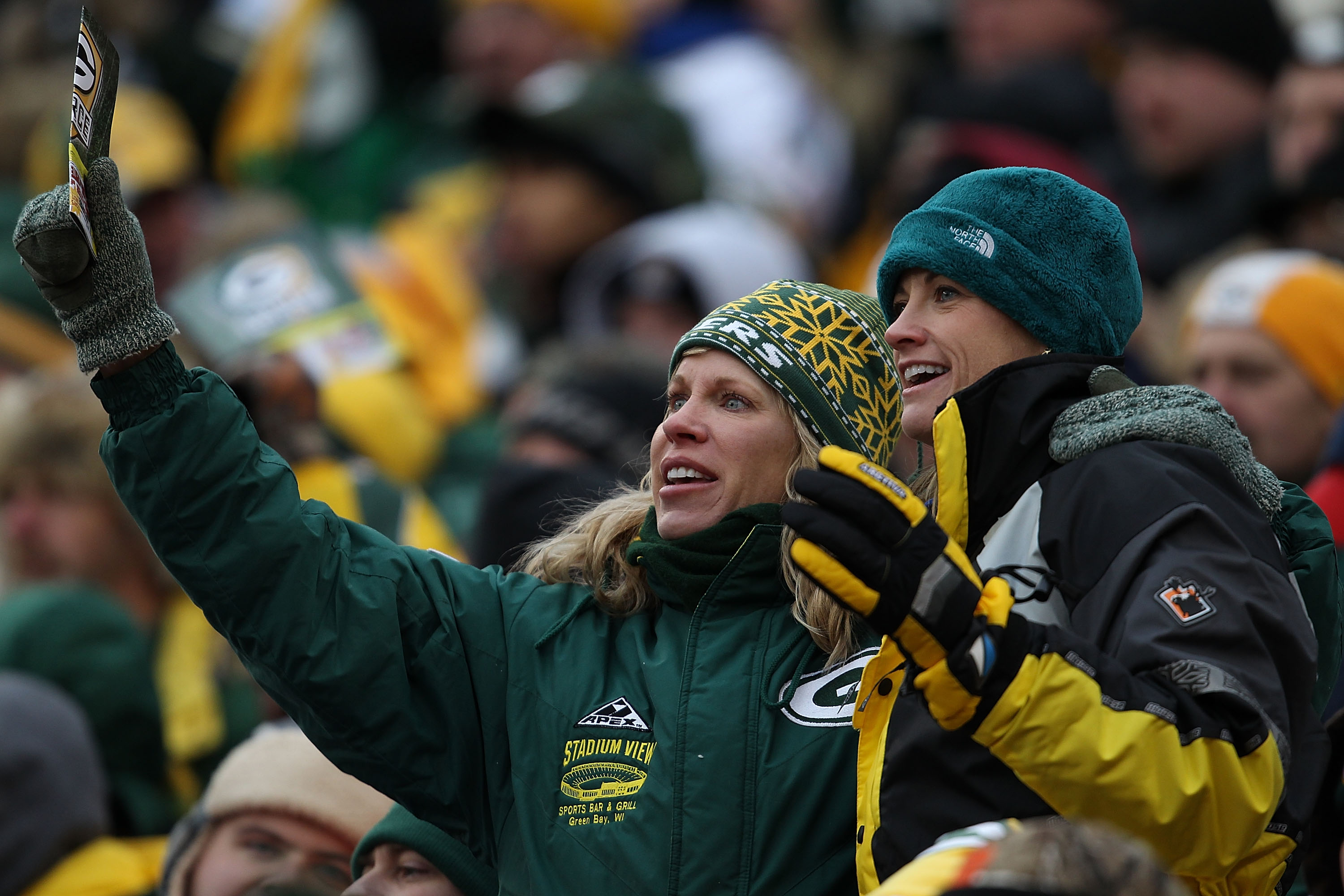 GREEN BAY, WI - DECEMBER 05: Fans of the Green Bay Packers cheer during a game against the San Francisco 49ers at Lambeau Field on December 5, 2010 in Green Bay, Wisconsin. The Packers defeated the 49ers 34-16. (Photo by Jonathan Daniel/Getty Images)