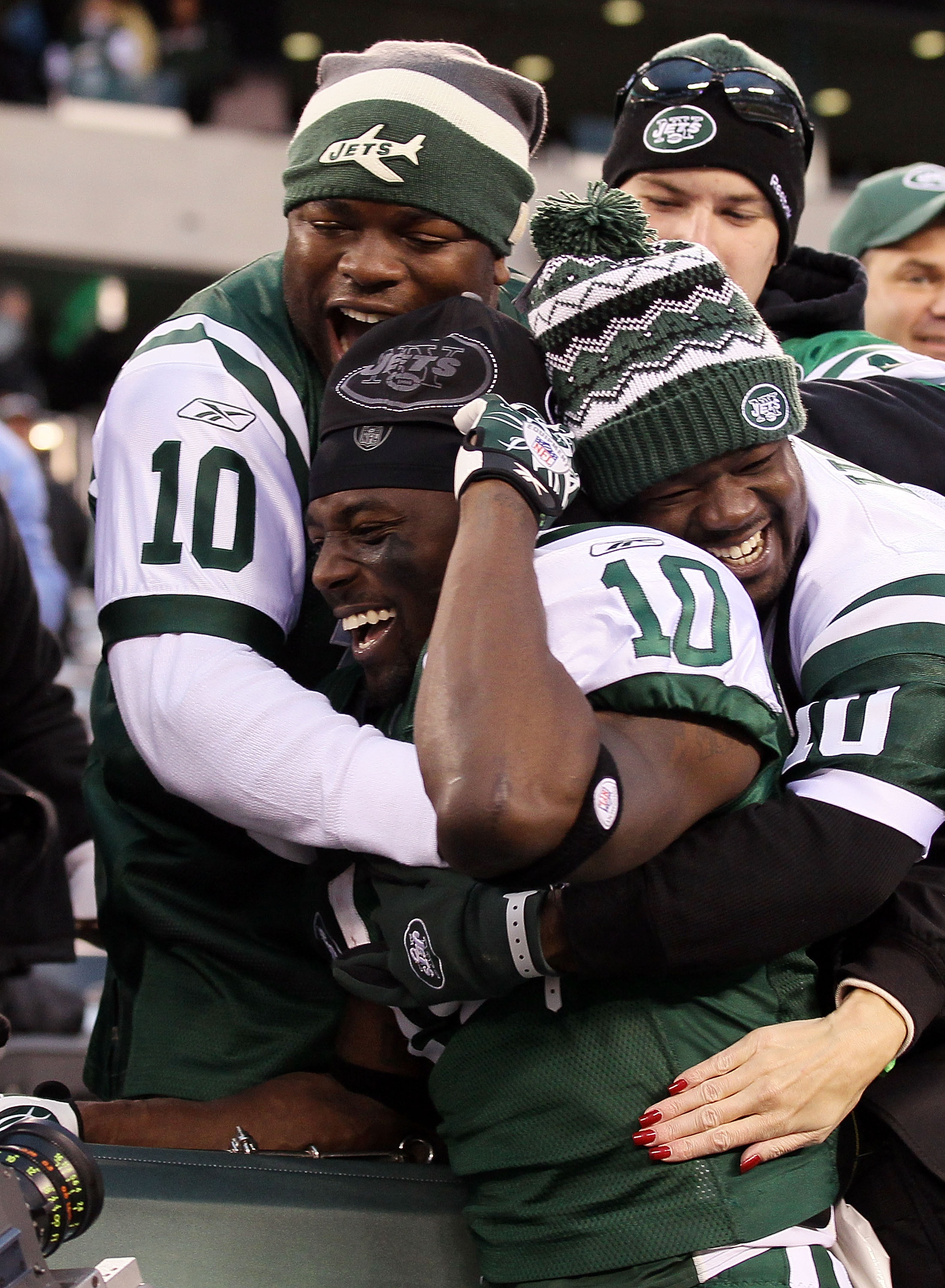 EAST RUTHERFORD, NJ - NOVEMBER 21:  Santonio Holmes #10 of the New York Jets celebrates with fans after defeating the Houston Texans on November 21, 2010 at the New Meadowlands Stadium in East Rutherford, New Jersey. The Jets defeated the Texans 30-27.  (