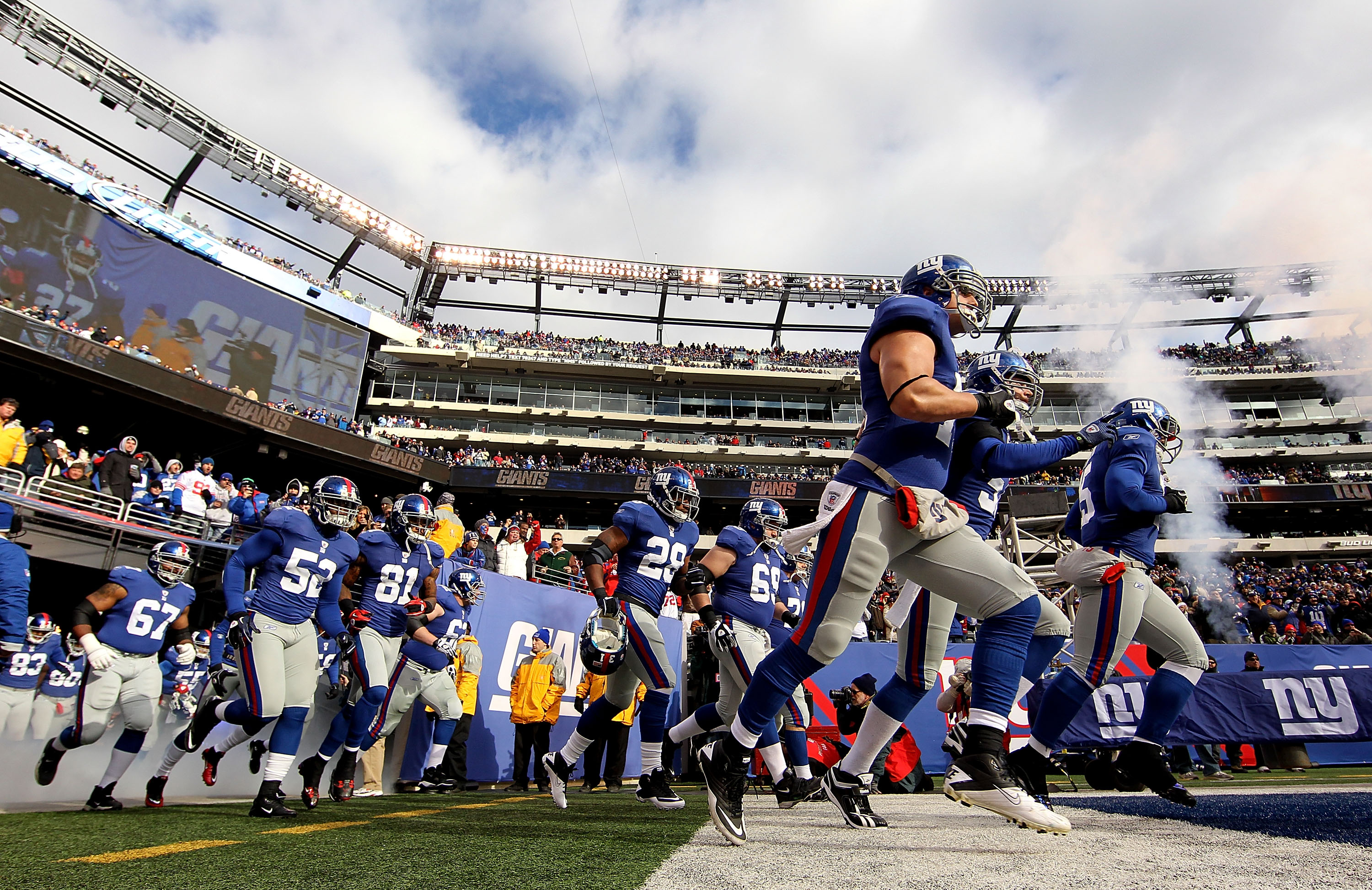 EAST RUTHERFORD, NJ - DECEMBER 05:  The New York Giants run onto the field before a game against the Washington Redskins on December 5, 2010 at The New Meadowlands Stadium in East Rutherford, New Jersey.  (Photo by Al Bello/Getty Images)