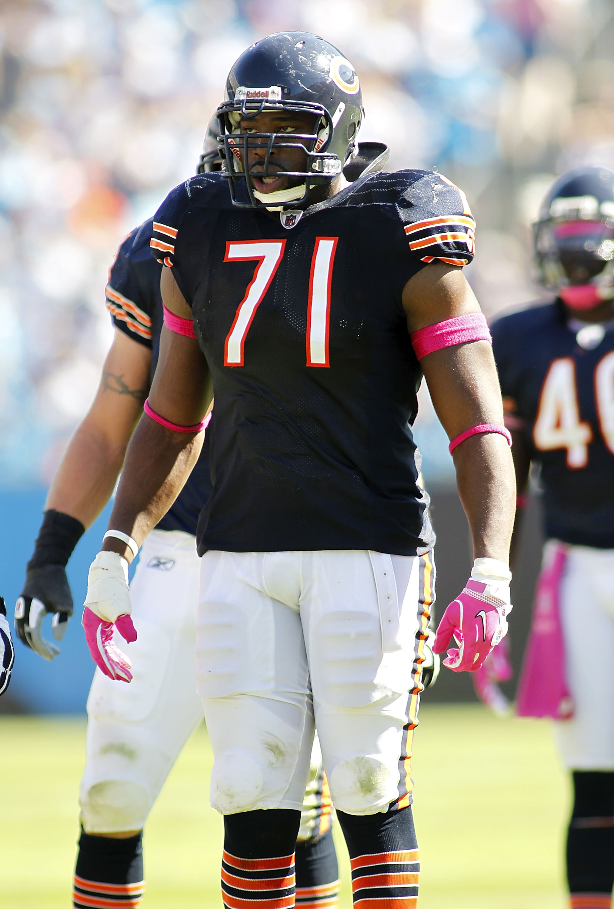 CHARLOTTE, NC - OCTOBER 10: Defensive tackle Israel Idonije #71 of the Chicago Bears stands on the field against the Carolina Panthers at Bank of America Stadium on October 10, 2010 in Charlotte, North Carolina. (Photo by Geoff Burke/Getty Images)