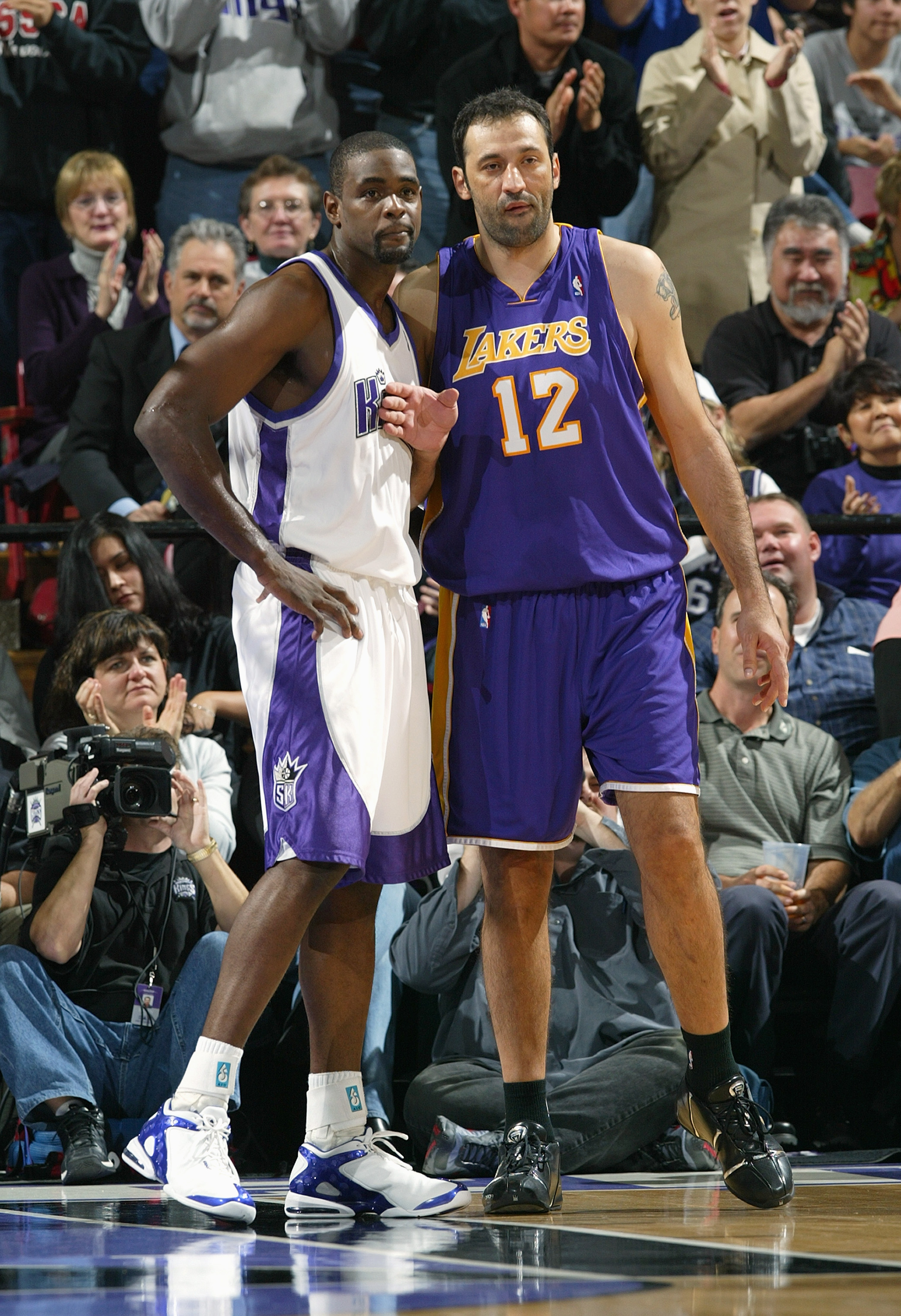 SACRAMENTO, CA - DECEMBER 16:  Chris Webber #4 of the Sacramento Kings and Vlade Divac #12 of the Los Angeles Lakers vie for position during their game on December 16, 2004 at Arco Arena  in Sacramento, California. The Lakers won 115-99. NOTE TO USER: Use