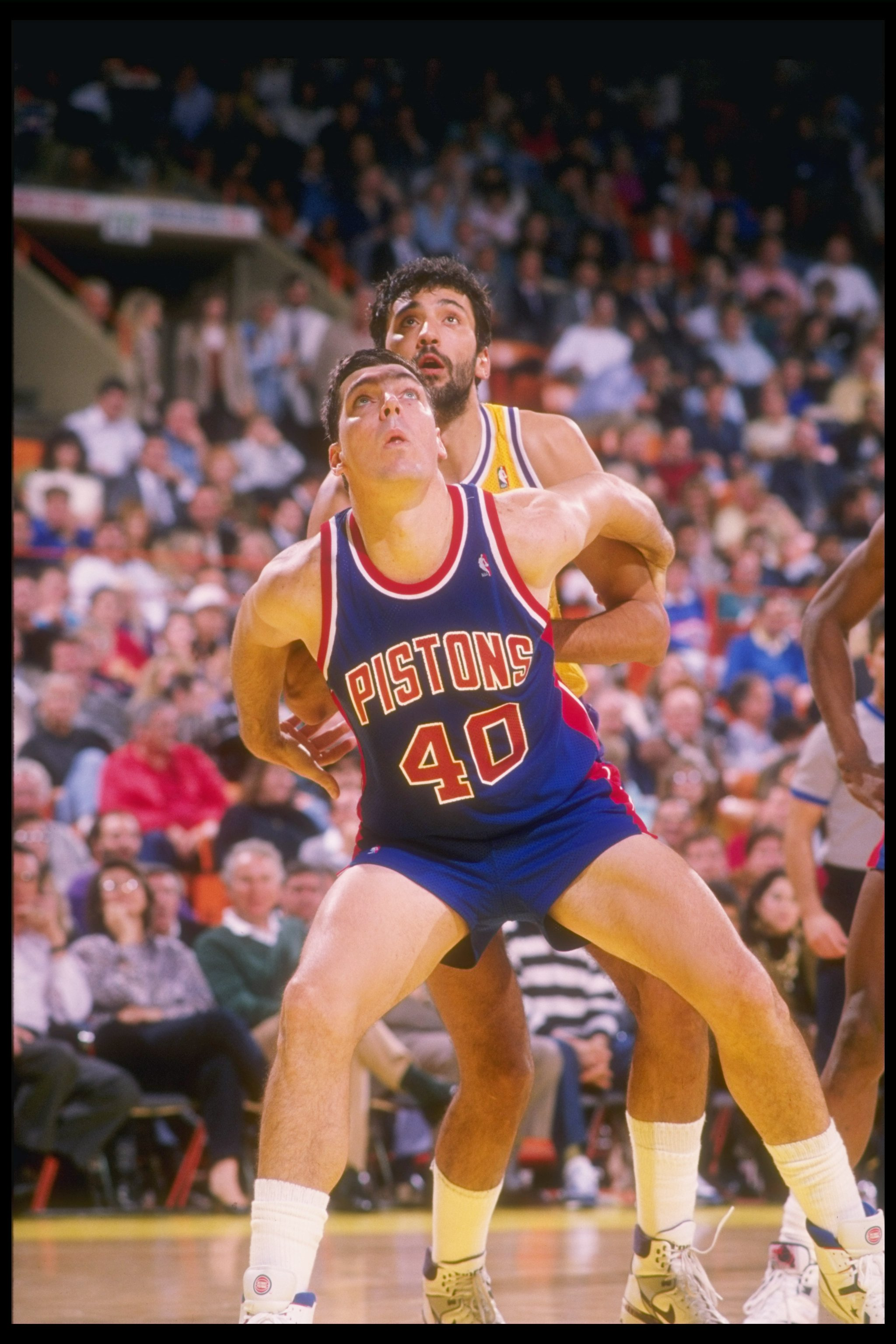 1989-1990:  Bill Laimbeer of the Detroit Pistons looks for the ball during a game. Mandatory Credit: Mike Powell  /Allsport Mandatory Credit: Mike Powell  /Allsport