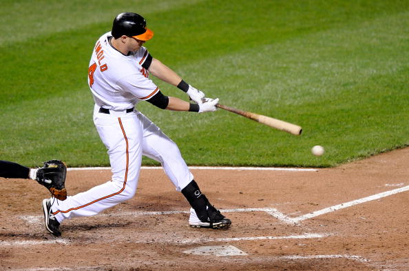 BALTIMORE - APRIL 27:  Nolan Reimold #14 of the Baltimore Orioles hits a single in the sixth inning against the New York Yankees at Camden Yards on April 27, 2010 in Baltimore, Maryland.  (Photo by Greg Fiume/Getty Images)