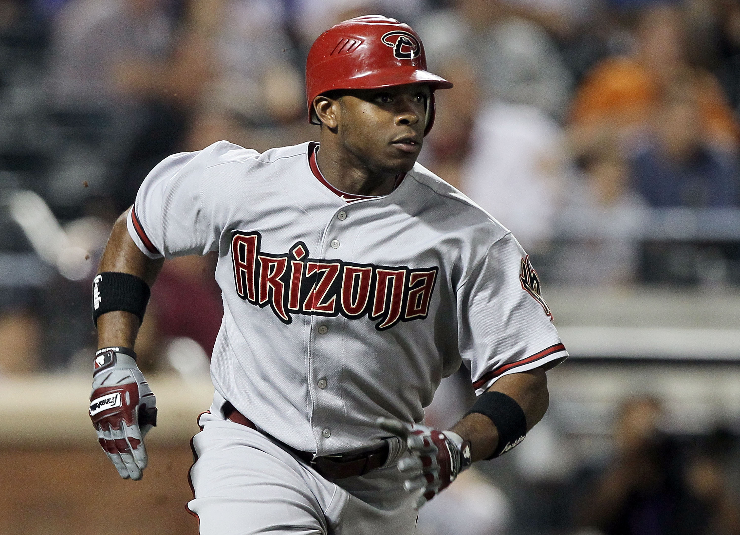 NEW YORK - JULY 31:  Justin Upton #10 of the Arizona Diamondbacks runs after hitting a seventh inning two run single against the New York Mets on July 31, 2010 at Citi Field in the Flushing neighborhood of the Queens borough of New York City.  (Photo by J