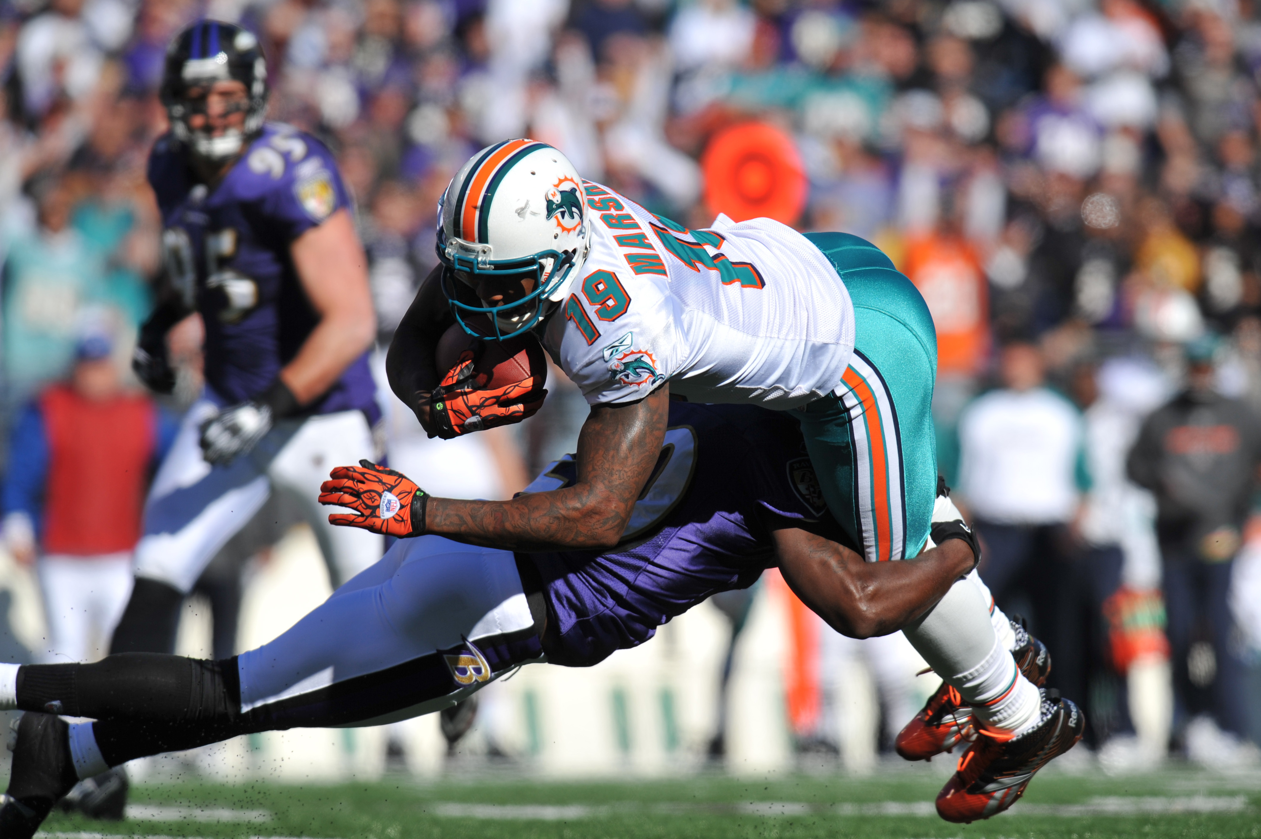 BALTIMORE, MD - NOVEMBER 7:  Brandon Marshall #19 of the Miami Dolphins runs the ball against the Baltimore Ravens at M&T Bank Stadium on November 7, 2010 in Baltimore, Maryland. The Ravens defeated the Dolphins 26-10. (Photo by Larry French/Getty Images)