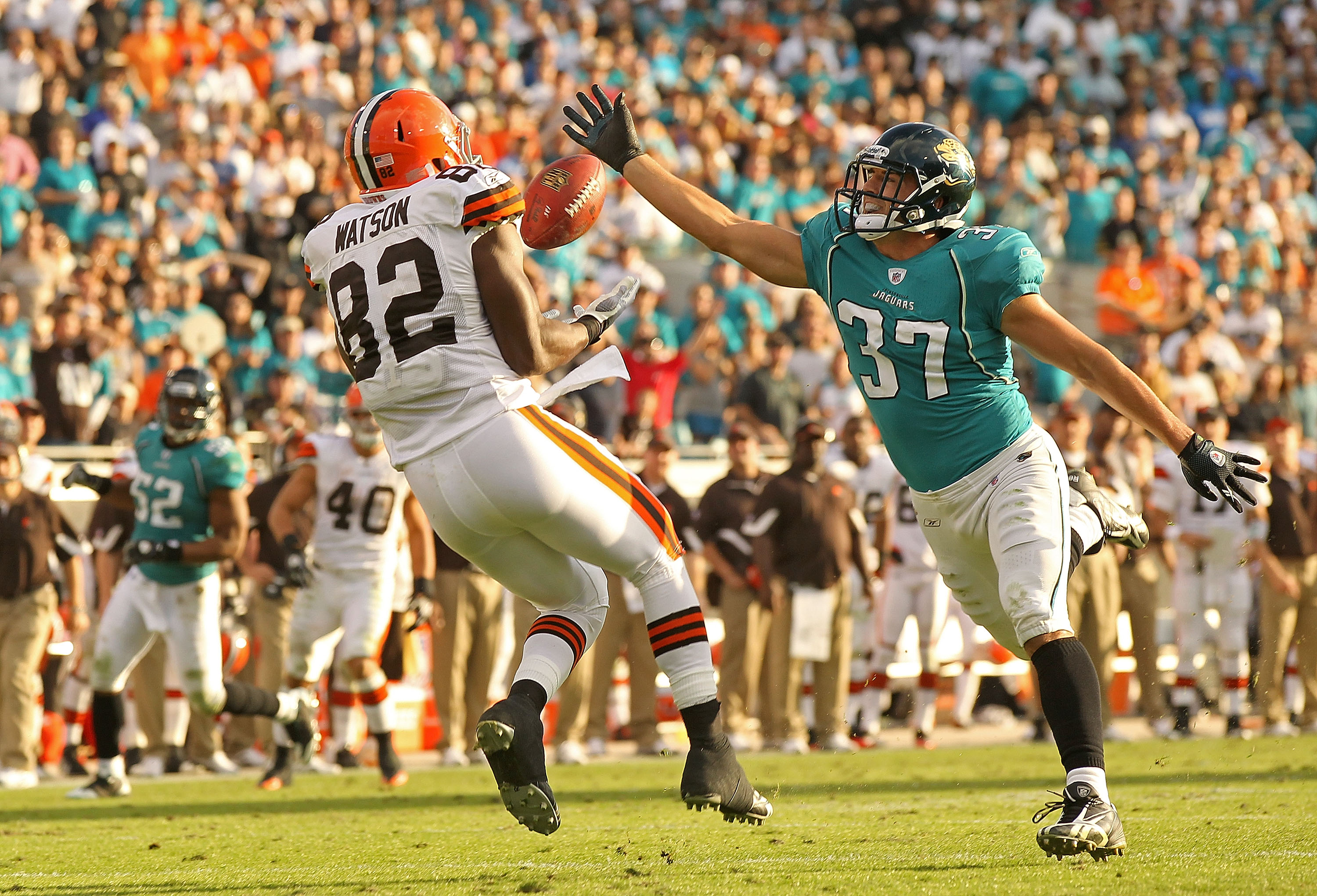 JACKSONVILLE, FL - NOVEMBER 21:  Sean Considine #37 of the Jacksonville Jaguars recovers an interception from Benjamin Watson #82 to end the game   agaisnt the Cleveland Browns at EverBank Field on November 21, 2010 in Jacksonville, Florida.  (Photo by Mi