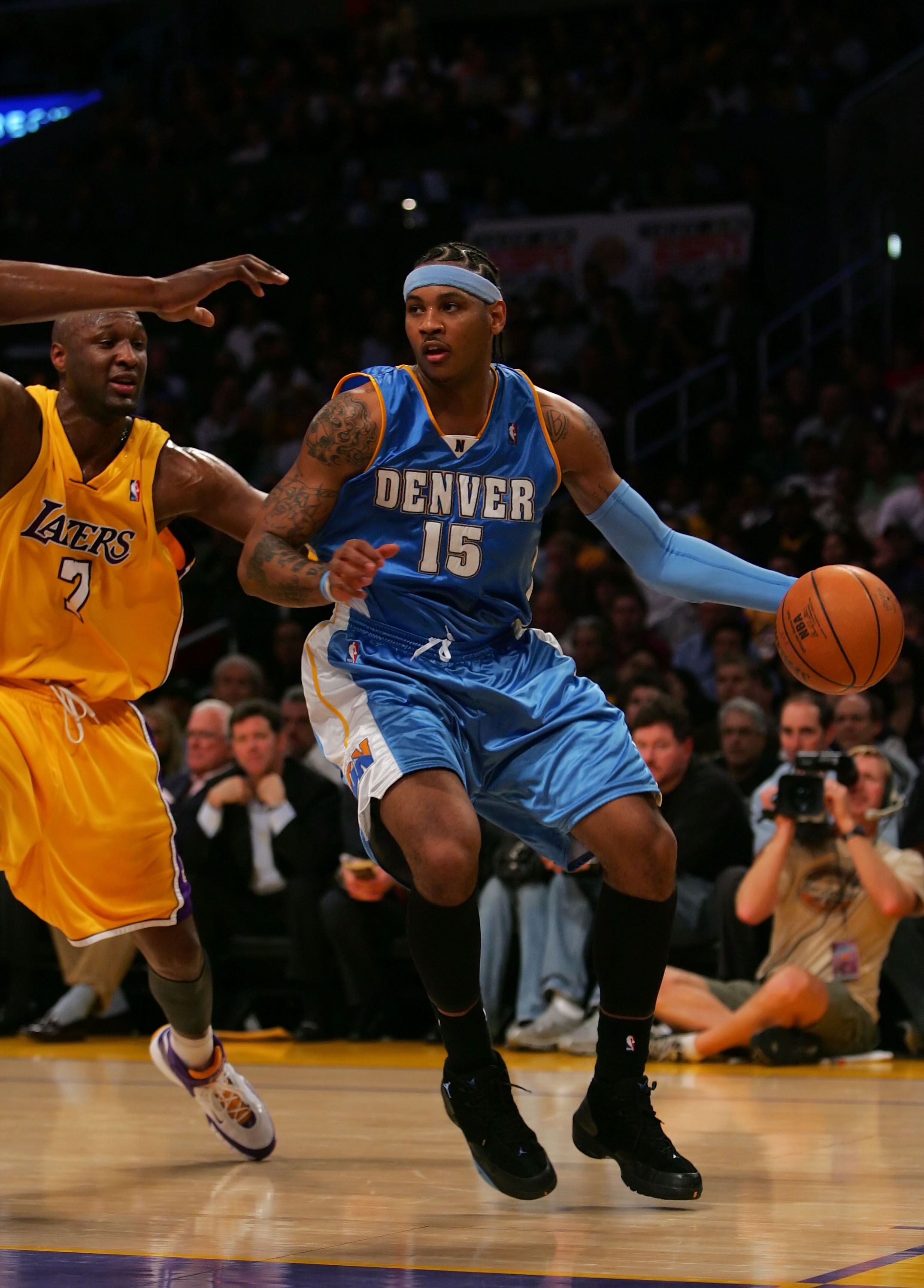 LOS ANGELES - APRIL 3:  Carmello Anthony #15 of the Denver Nuggets drives against Lamar Odom #7 of the Los Angeles Lakers at Staples Center April 3, 2007 in Los Angeles, California.  NOTE TO USER: User expressly acknowledges and agrees that, by downloadin