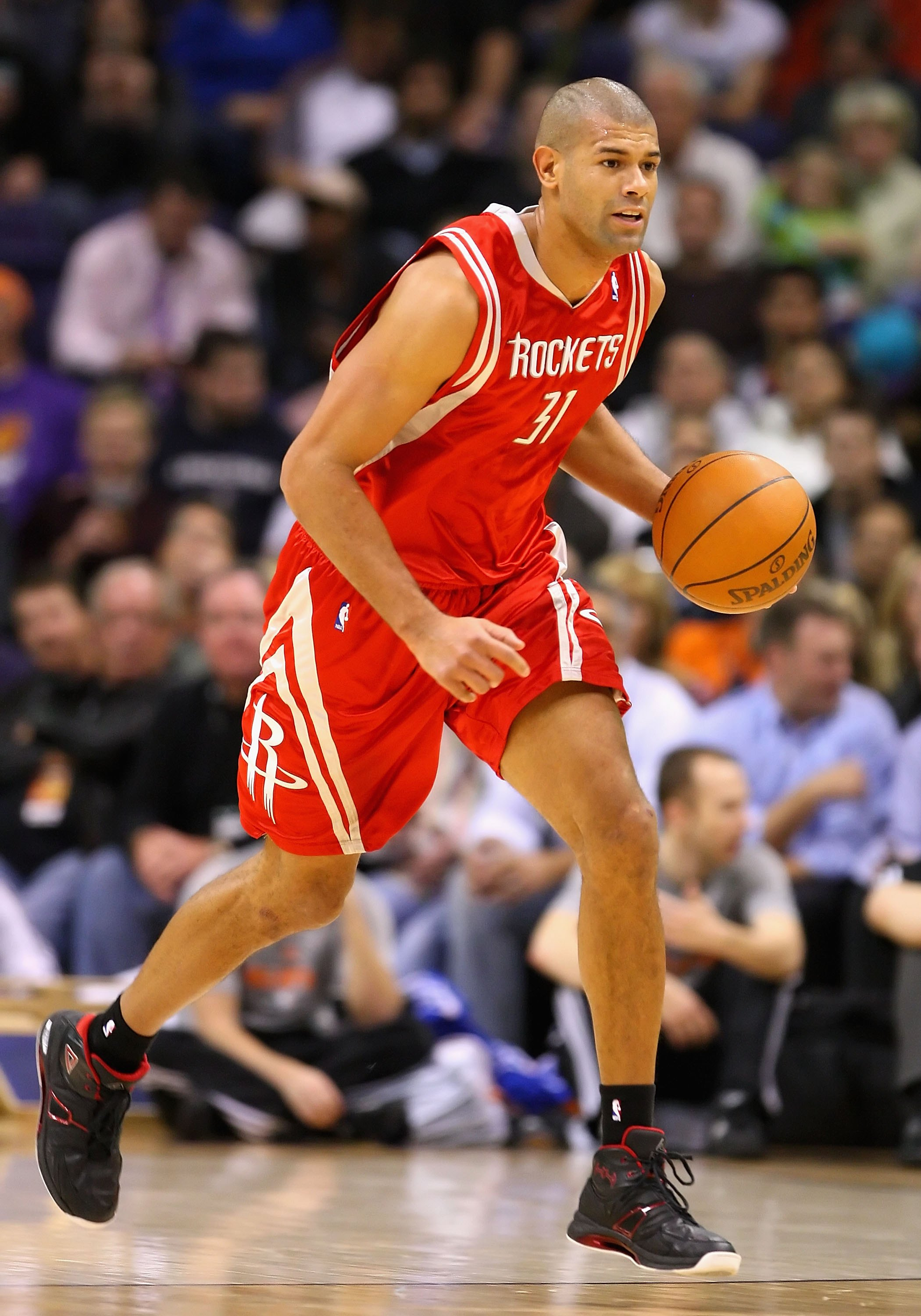 PHOENIX - JANUARY 06:  Shane Battier #31 of the Houston Rockets handles the ball during the NBA game against the Phoenix Suns at US Airways Center on January 6, 2010 in Phoenix, Arizona. The Suns defeated the Rockets 118-110.  NOTE TO USER: User expressly