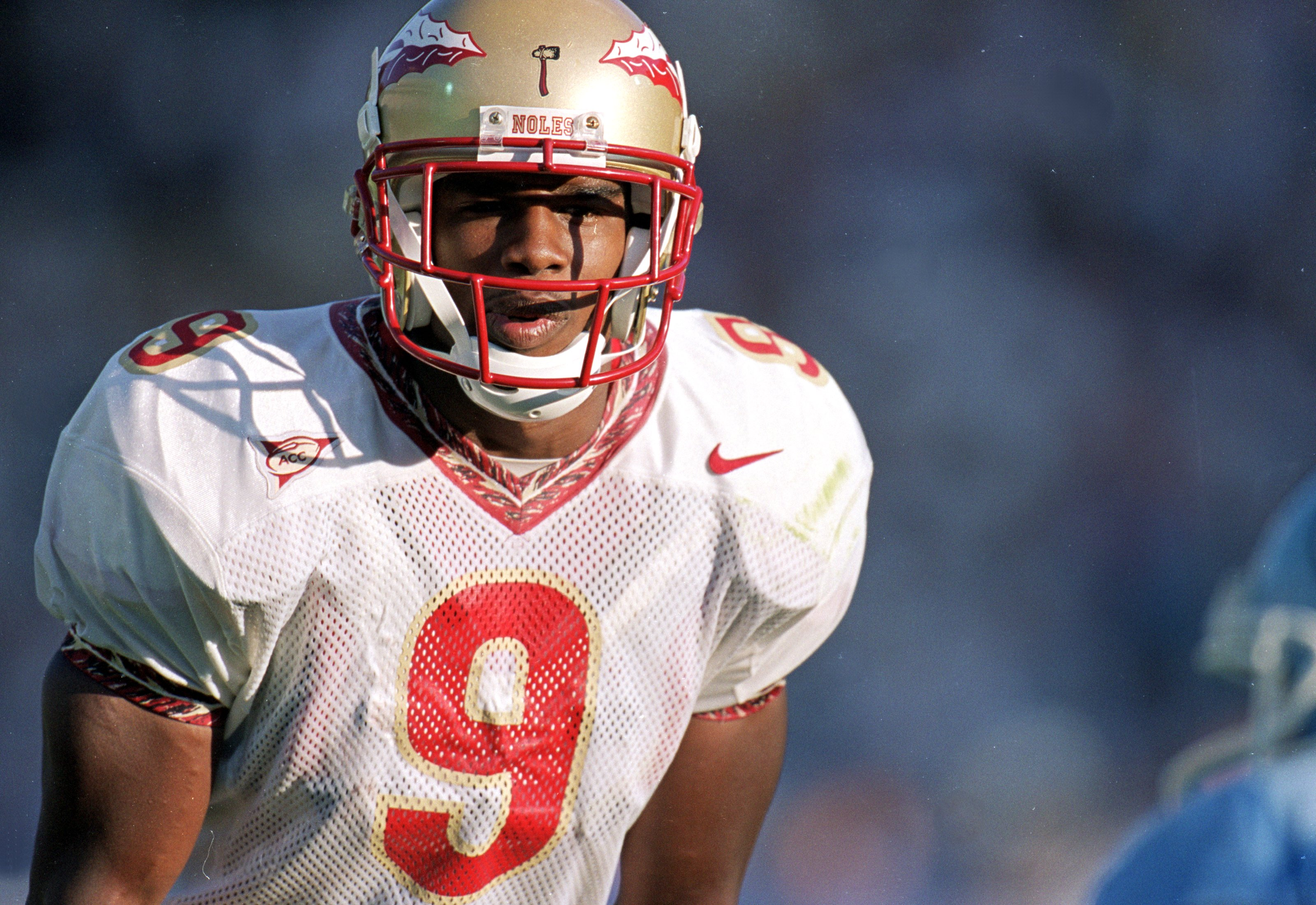25 Sep 1999: Peter Warrick #9 of the Florida State Seminoles gets ready to run during the game against the North Carolina Tar Heels at the Kenan Stadium in Chapel Hill, North Carolina. The Seminoles defeated the Tar Heels 42-10.