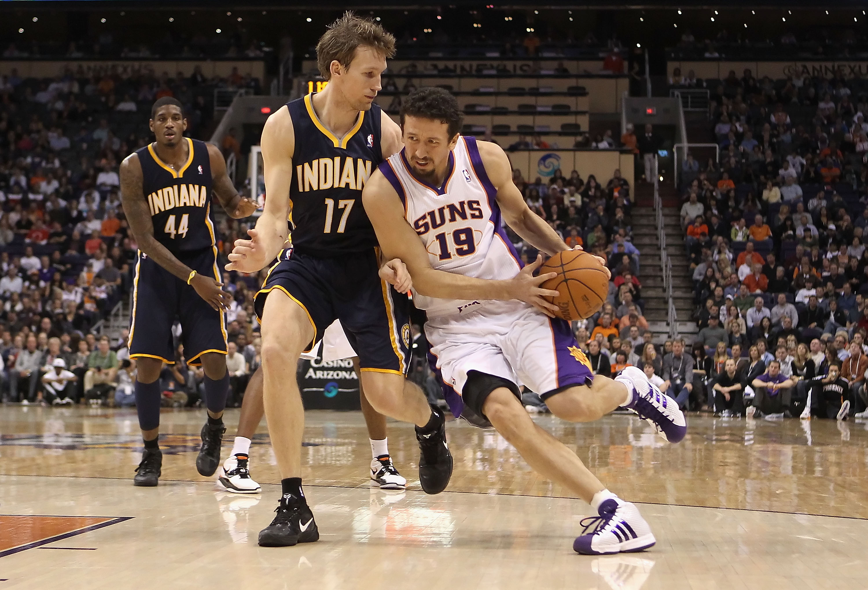 PHOENIX - DECEMBER 03:  Hedo Turkoglu #19 of the Phoenix Suns drives with the ball against Mike Dunleavy #17 of the Indiana Pacers during the NBA game at US Airways Center on December 3, 2010 in Phoenix, Arizona.  The Suns defeated the Pacers 105-97.  NOT