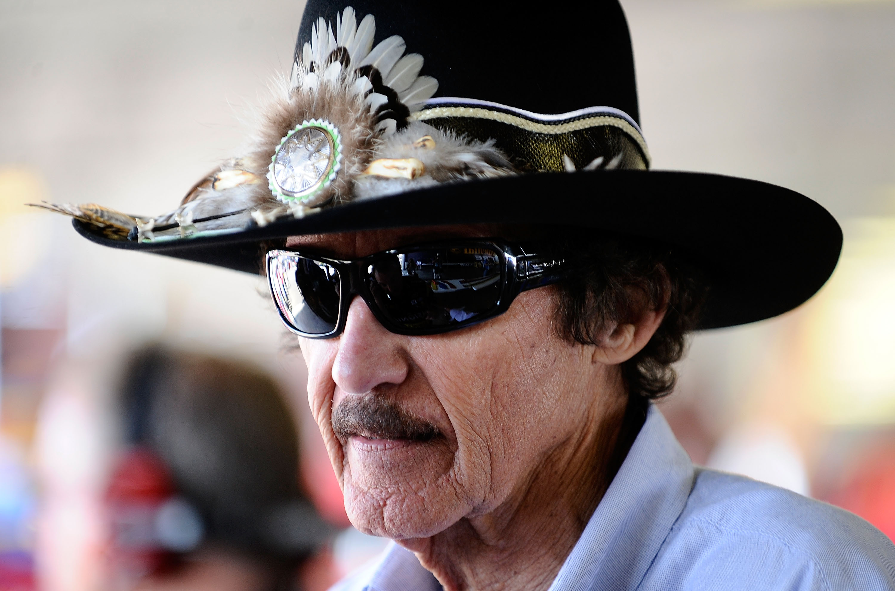 WATKINS GLEN, NY - AUGUST 06:  Team owner Richard Petty stands in the garage during practice for the NASCAR Heluva Good! Sour Cream Dips at The Glen on August 6, 2010 in Watkins Glen, New York.  (Photo by Jeff Zelevansky/Getty Images for NASCAR)