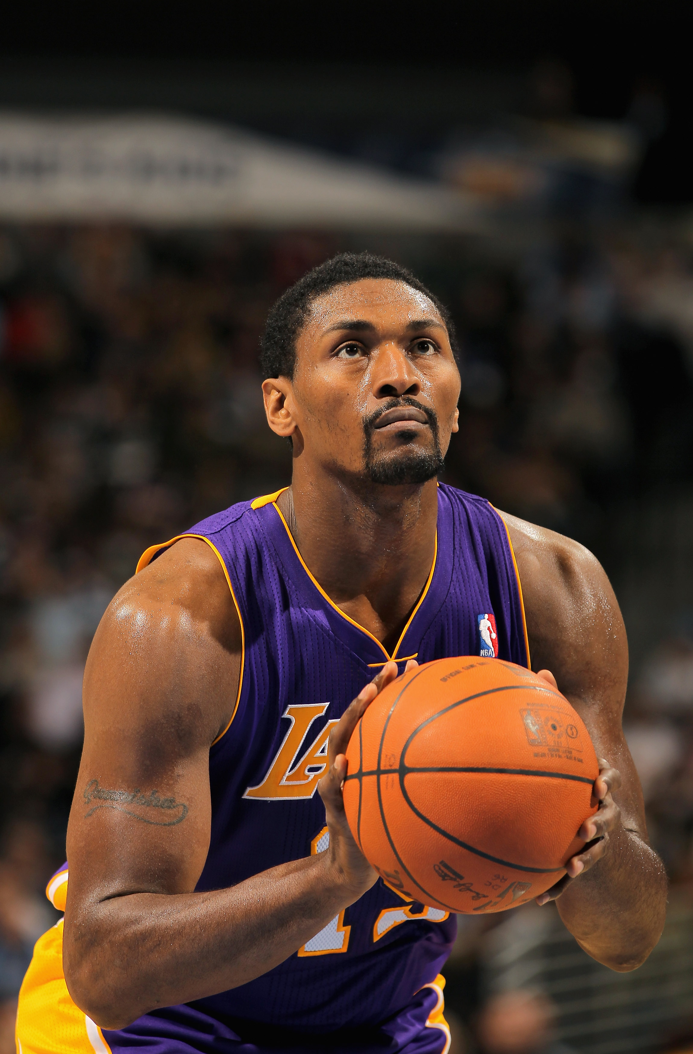 DENVER - NOVEMBER 11:  Ron Artest #15 of the Los Angeles Lakers takes a free throw against the Denver Nuggets at the Pepsi Center on November 11, 2010 in Denver, Colorado. The Nuggets defeated the Lakers 118-112.  NOTE TO USER: User expressly acknowledges