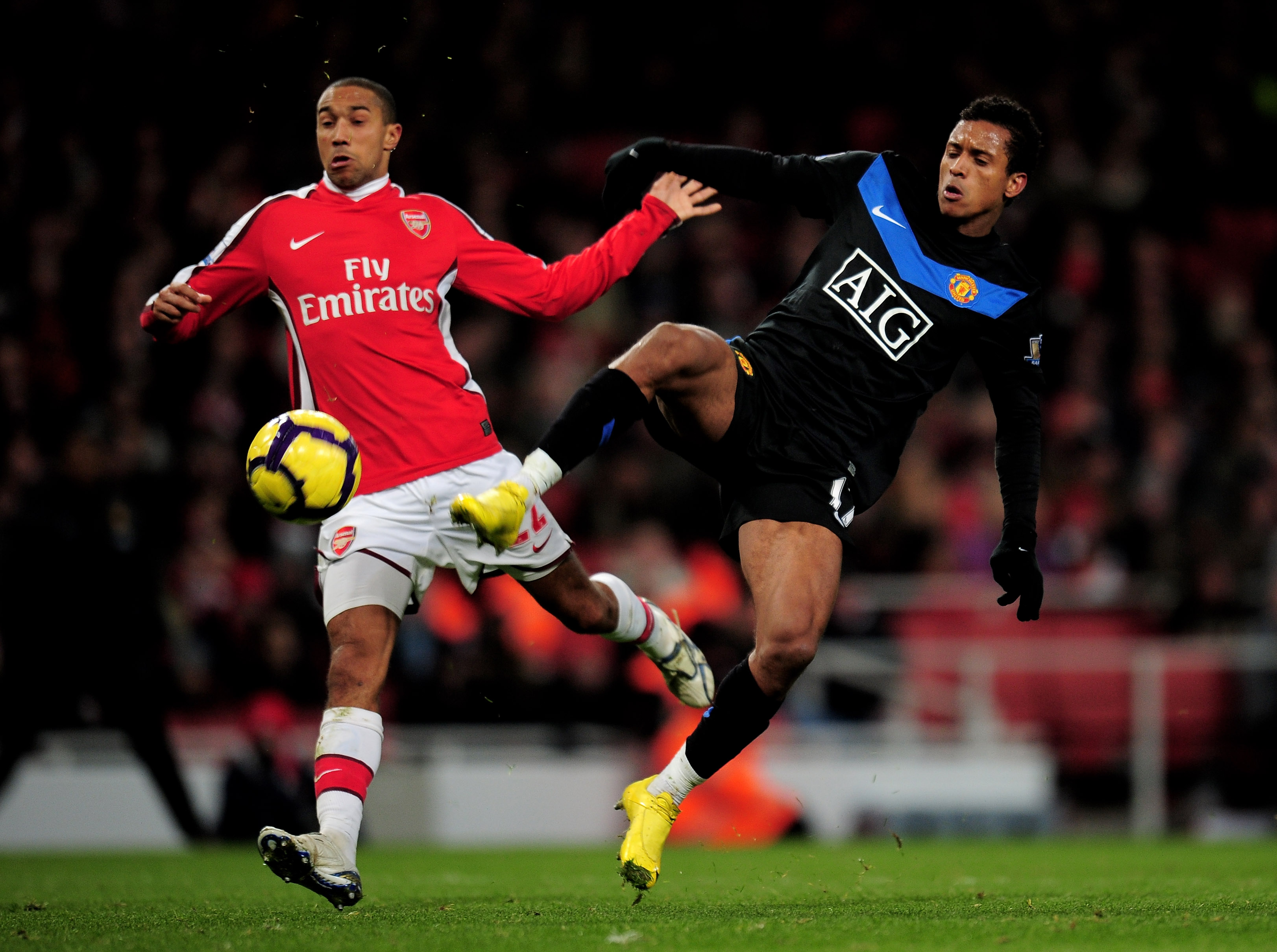 LONDON, ENGLAND - JANUARY 31:  Gael Clichy of Arsenal and Nani of Manchester United battle for the ball during the Barclays Premier League match between Arsenal and Manchester United at The Emirates Stadium on January 31, 2010 in London, England.  (Photo