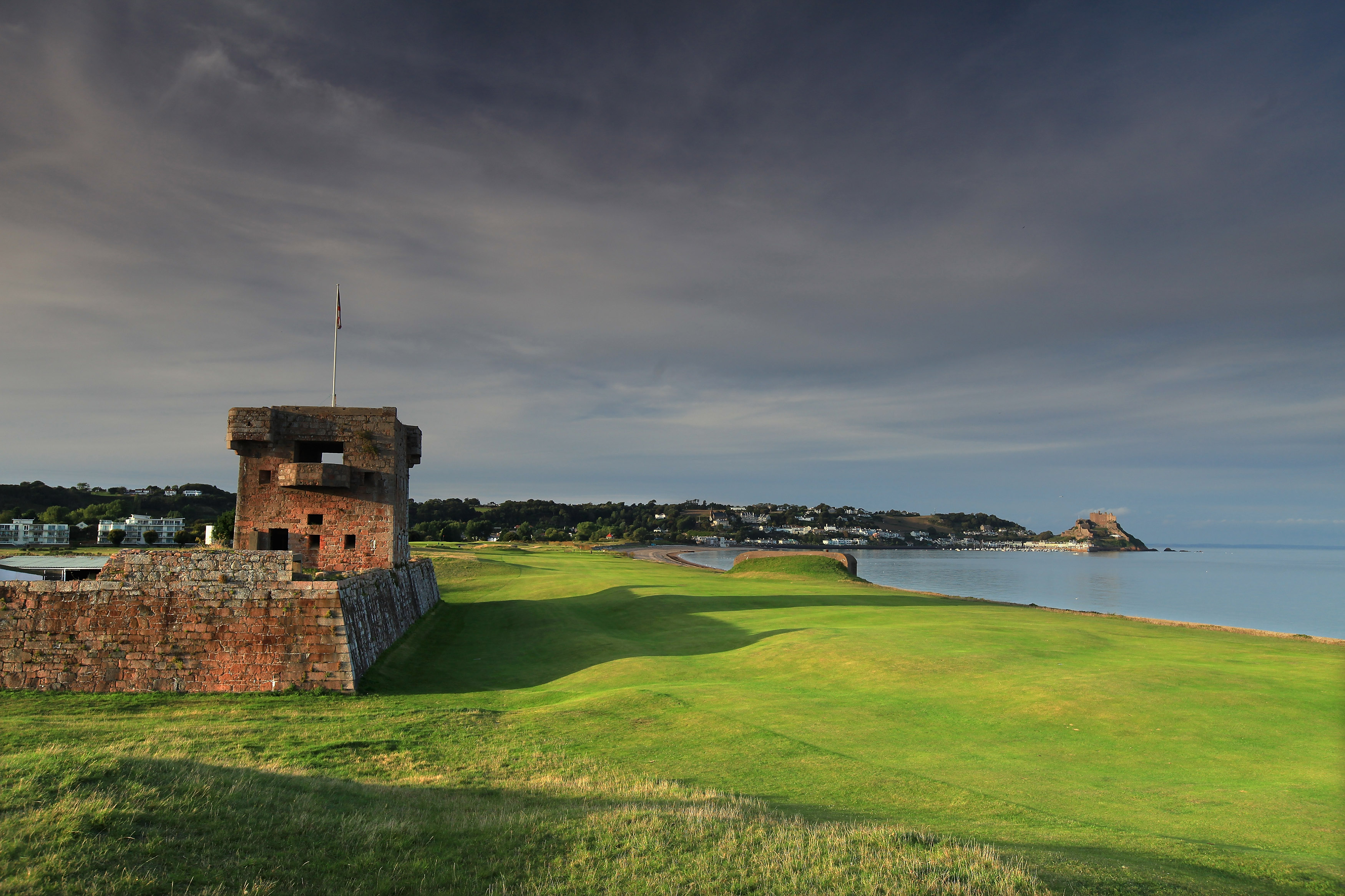 GROUVILLE, JERSEY - SEPTEMBER 19:  The 470 yards par 5, 1st hole that runs between the bay and the sea defences from World War II and Fort Henry on the left at The Royal Jersey Golf Club on September 19, 2010 in Grouville, Jersey, Channel Islands.  (Photo