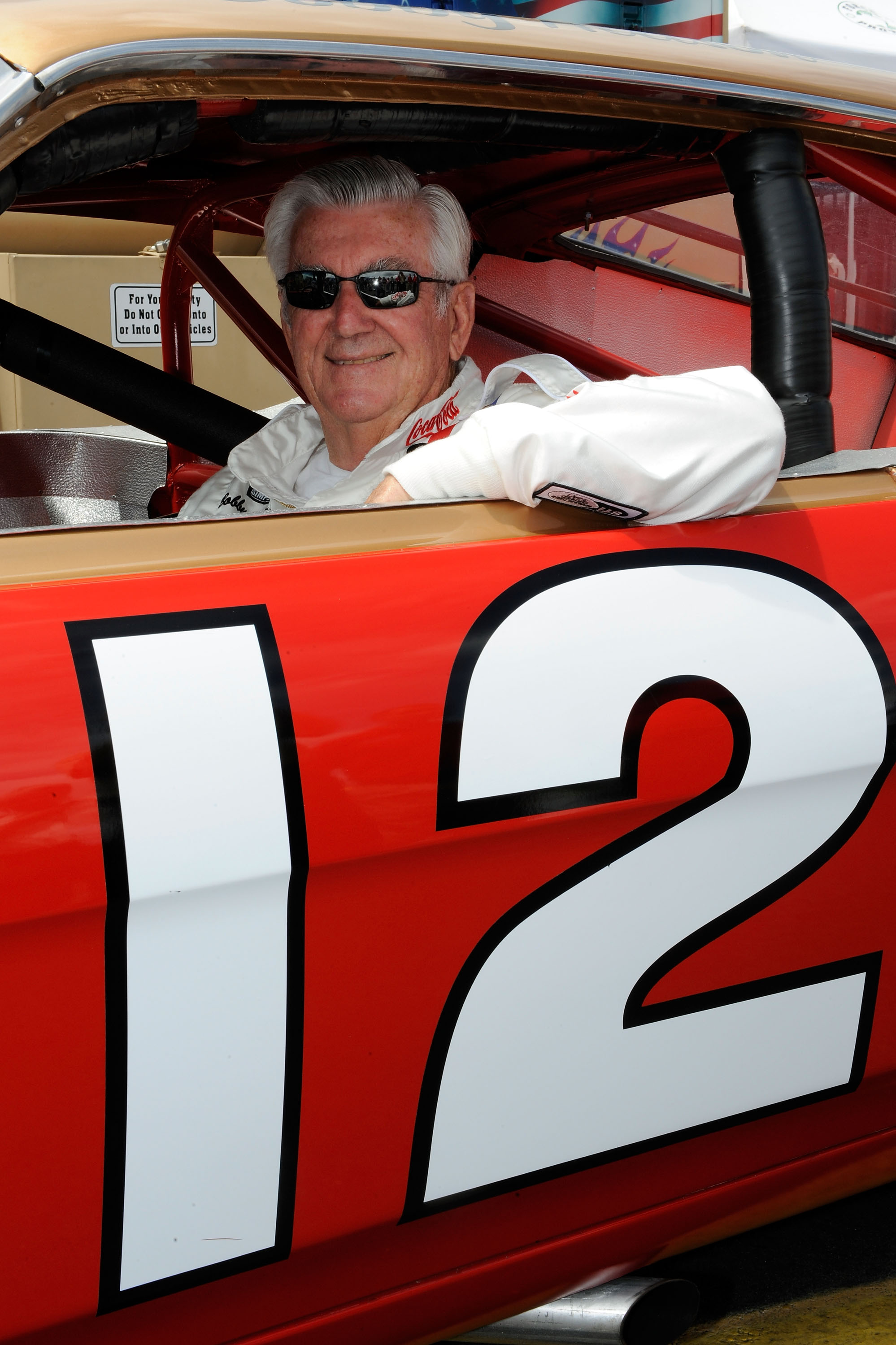 CONCORD, NC - MAY 24:  NASCAR legend Bobby Allison poses in the #12 Car in the garage area prior to the NASCAR Sprint Cup Series Coca-Cola 600 on May 24, 2009 at Lowe's Motor Speedway in Concord, North Carolina.  (Photo by John Harrelson/Getty Images)