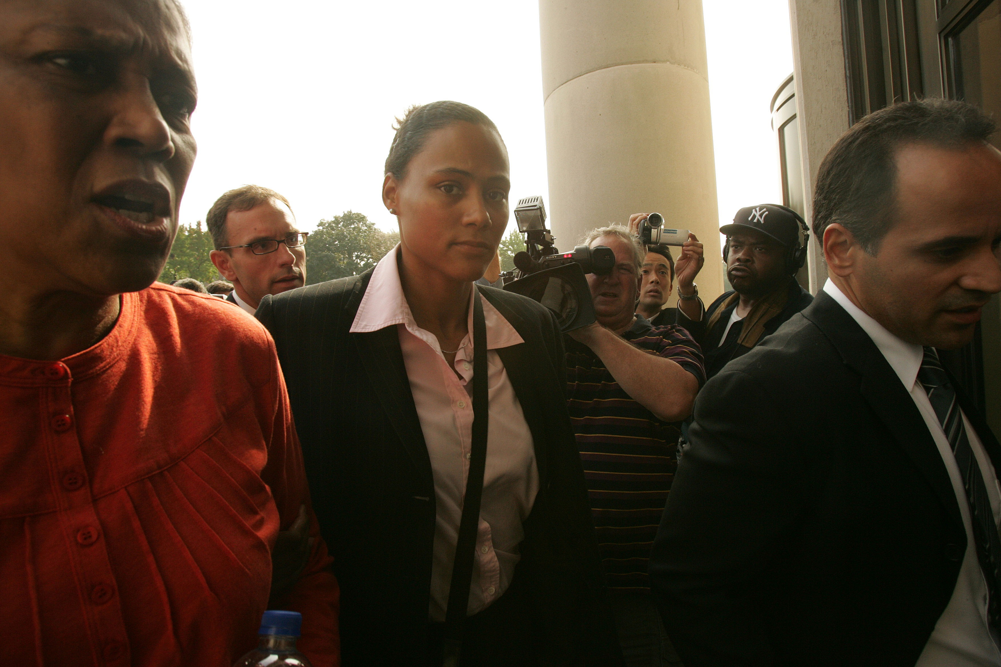 WHITE PLAINS, NY - OCTOBER 5:  Three-time Olympic gold medalist Marion Jones (C) enters a United States federal courthouse October 5, 2007 in White Plains, New York. Jones is expected to plead guilty to charges in connection with steroid use.  (Photo by H