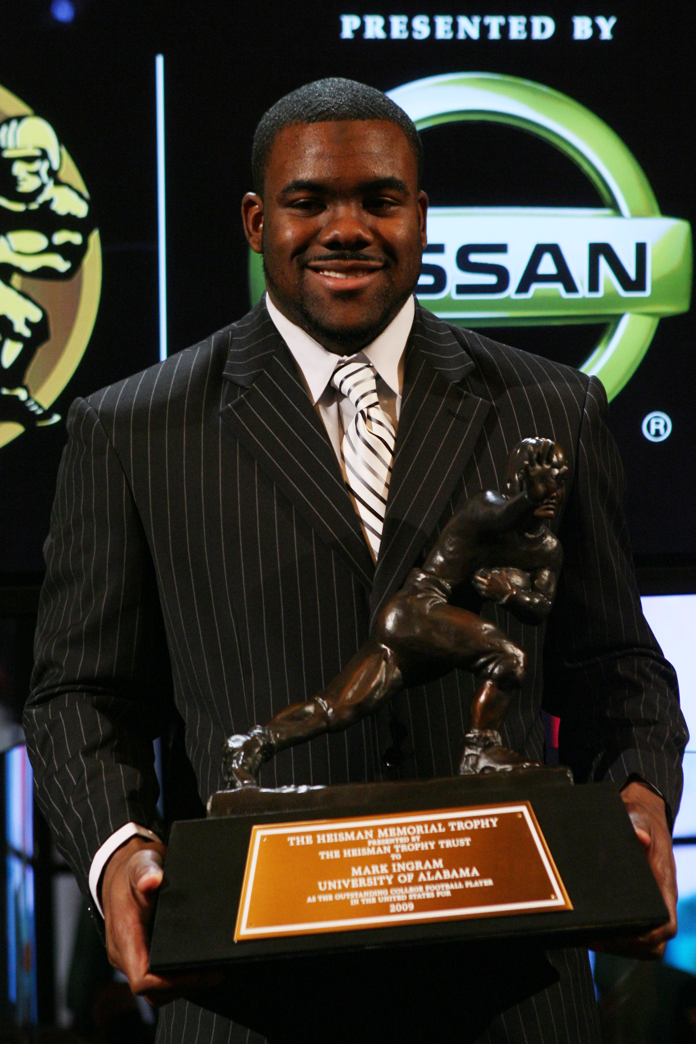 NEW YORK - DECEMBER 12:  Running back Mark Ingram #22 of the Alabama Crimson Tide poses with the Heisman Trophy during a press conference after being named the 75th Heisman Trophy winner at the Marriott Marquis on December 12, 2009 in New York City.  (Pho