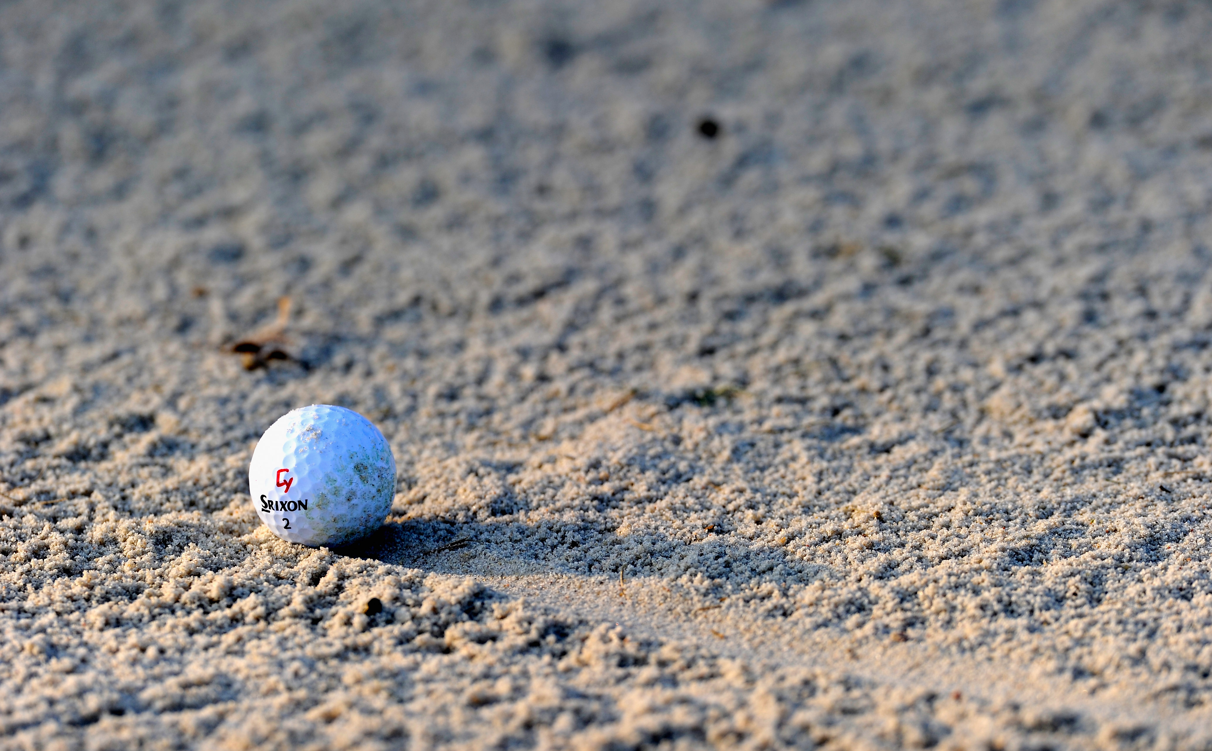 GIRONA, SPAIN - DECEMBER 10:  A ball in a bunker during the final round of the European Tour qualifying school final stage at PGA golf de Catalunya on December 10, 2010 in Girona, Spain.  (Photo by Stuart Franklin/Getty Images)