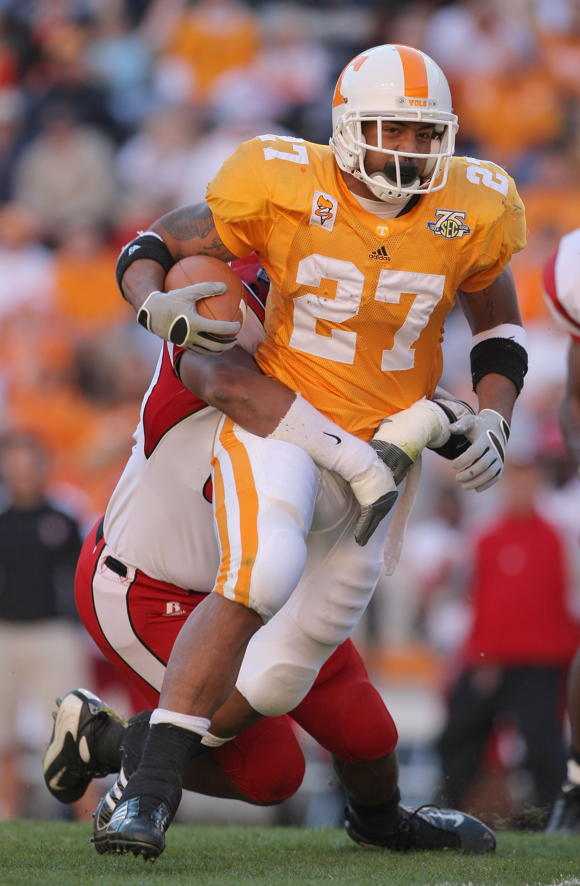 KNOXVILLE, TN - NOVEMBER 03:  Arian Foster #27 of the Tennessee Volunteers carries the ball against the Louisiana Lafayette Cajuns during the first quarter at Neyland Stadium on November 3, 2007 in Knoxville, Tennessee.  (Photo by Harry How/Getty Images)