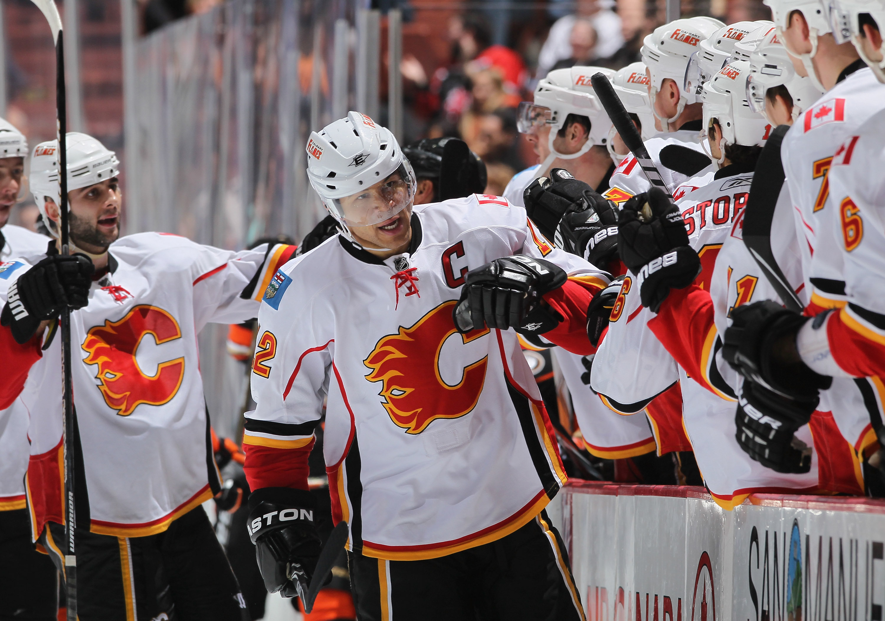 ANAHEIM, CA - DECEMBER 10:  Jerome Iginla #12 of the Calgary Flames receives high fives from the bench after scoring a goal against the Anaheim Ducks in the third period at the Honda Center on December 10, 2010 in Anaheim, California. The Ducks defeated t