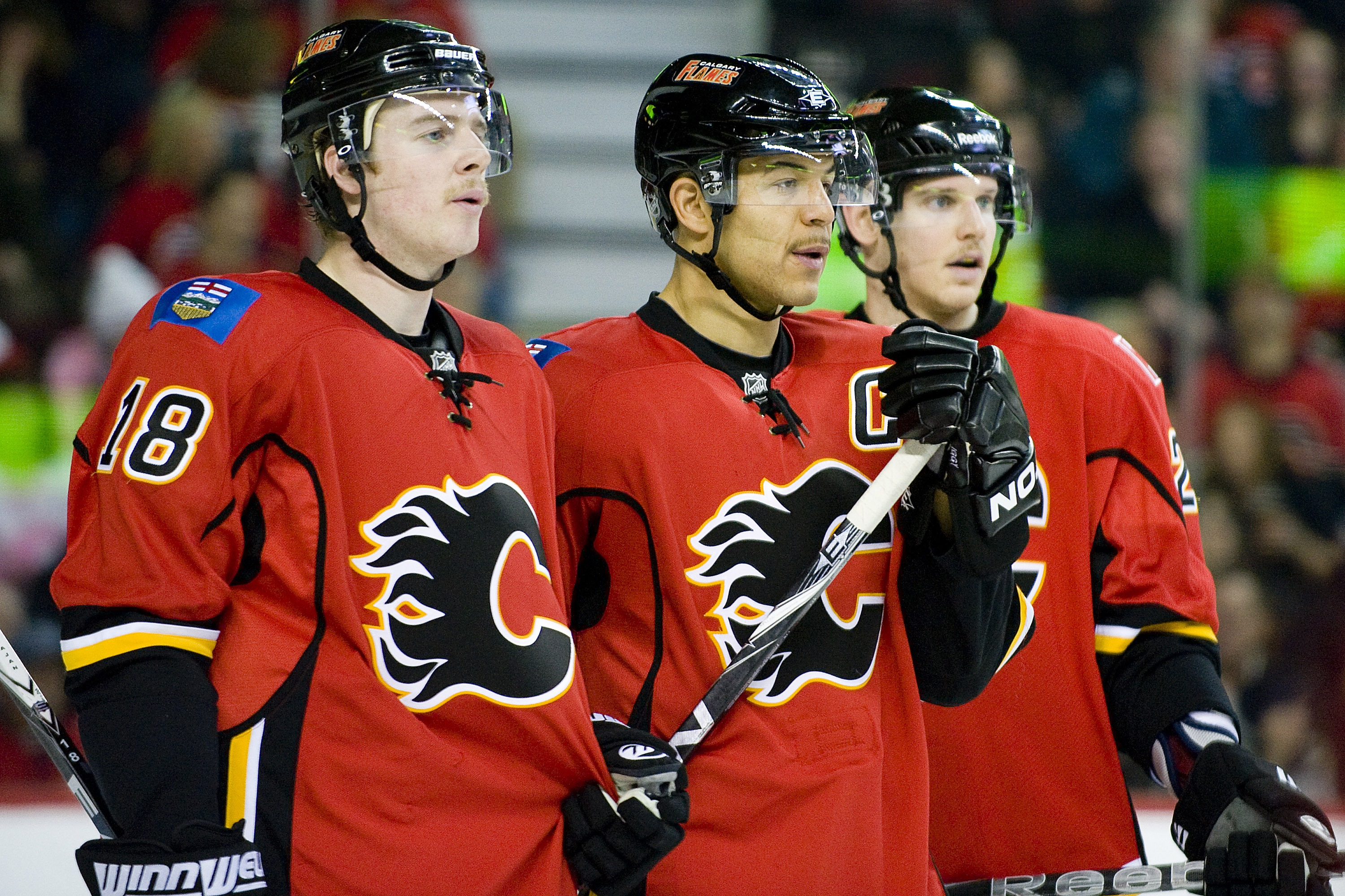 EDMONTON, AB - NOVEMBER 29:  (L-R) Matt Stajan #18, Jarome Iginla and Brendan Mikkelson #29 of the Calgary Flames rest during a stoppage of play against the Minnesota Wild at Scotiabank Saddledome on November 29, 2010 in Calgary, Alberta, Canada. The Flam