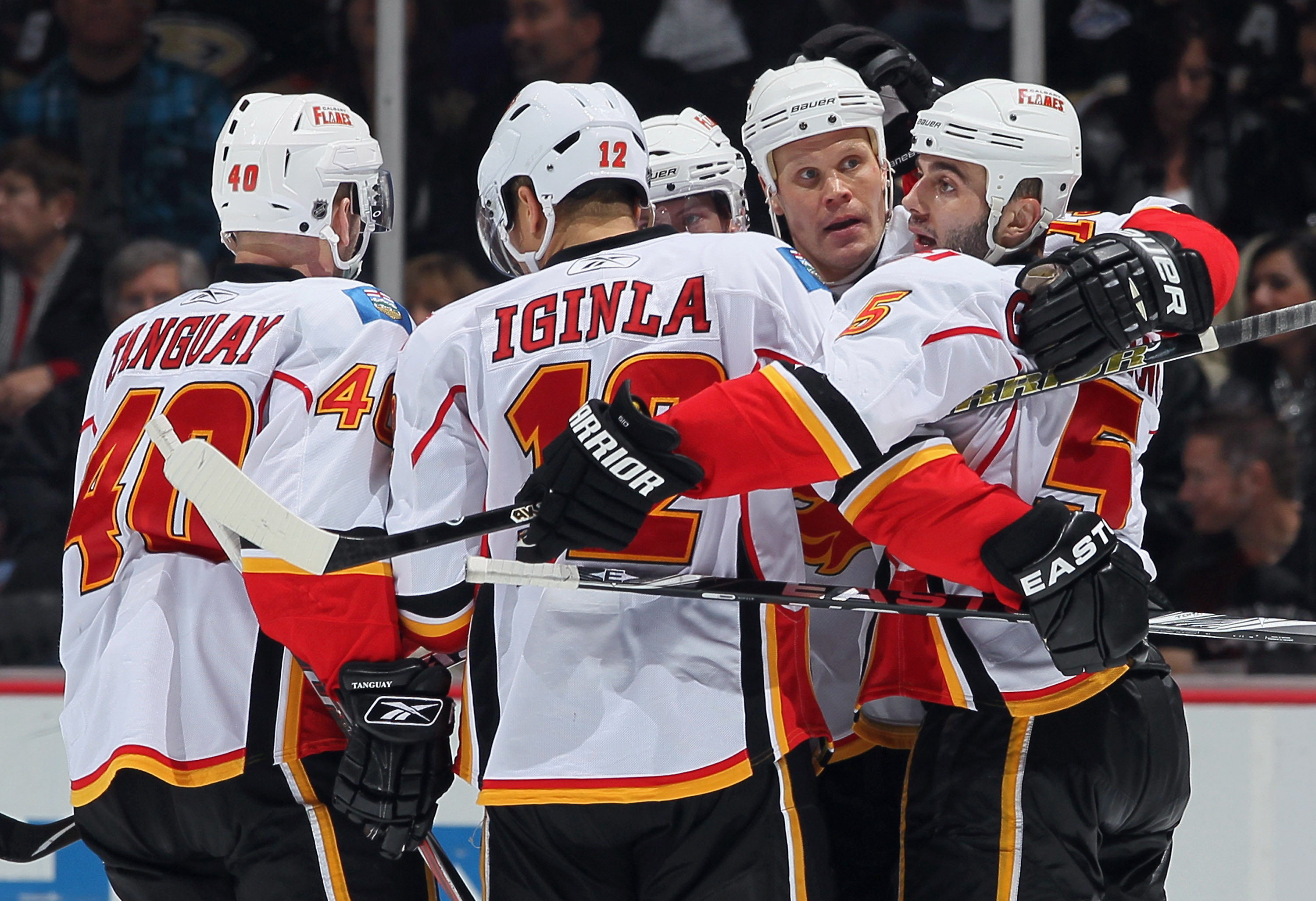 ANAHEIM, CA - DECEMBER 10:  (L-R) Alex Tanguay, #40, Jerome Iginla #12, Olli Jokinen #13 and Mark Giordano #5 of the Calgary Flames celebrate Jokinen's goal against the Anaheim Ducks in the third period at the Honda Center on December 10, 2010 in Anaheim,