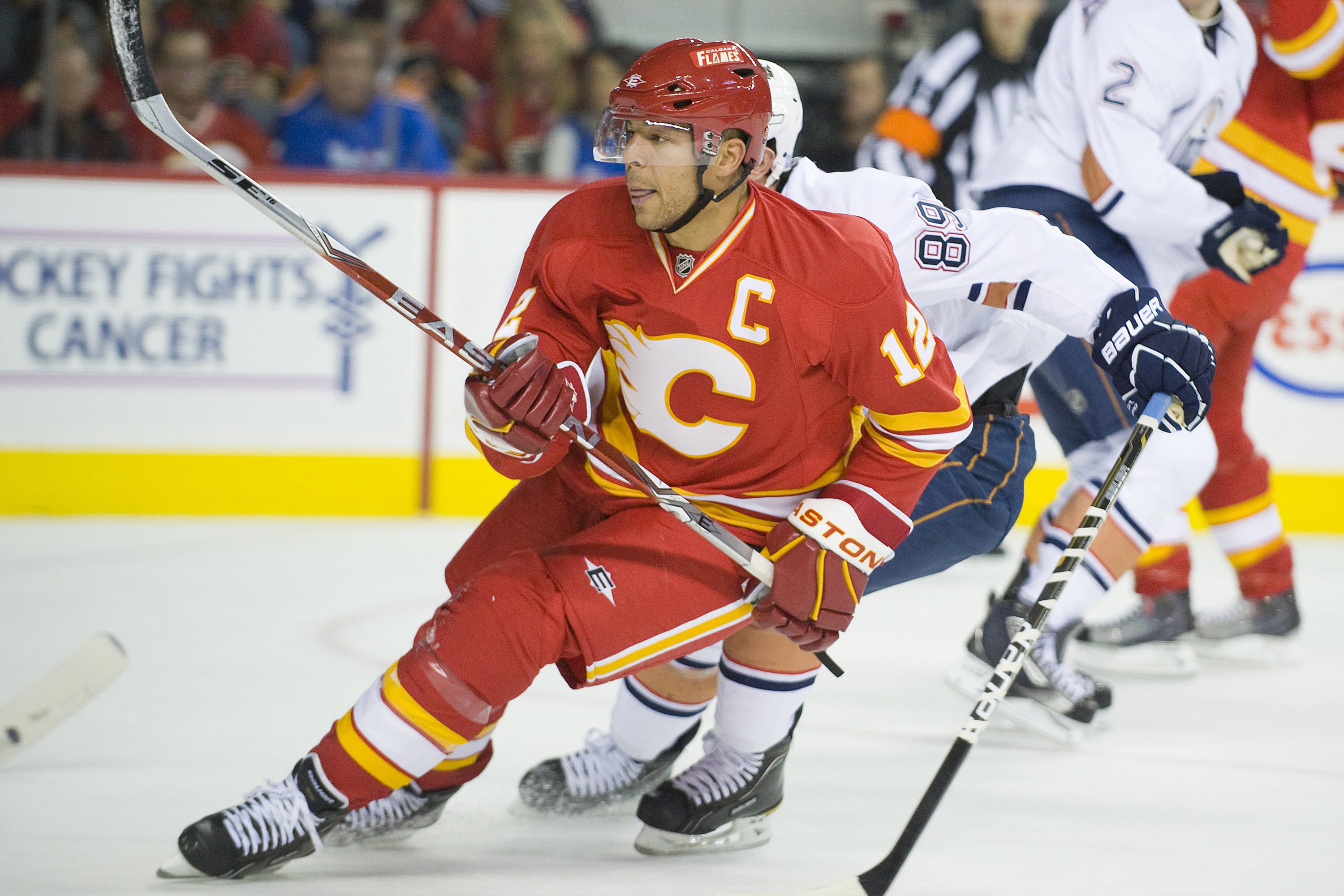 EDMONTON, CANADA - OCTOBER 16:  Calgary Flames right wing Jarome Iginla #12 reacts to the play against the Edmonton Oilers at the Scotiabank Saddledome  on October 16, 2010 in Calgary, Alberta, Canada.  The Flames beat the Oilers 5-3.  (Photo by Dylan Lyn