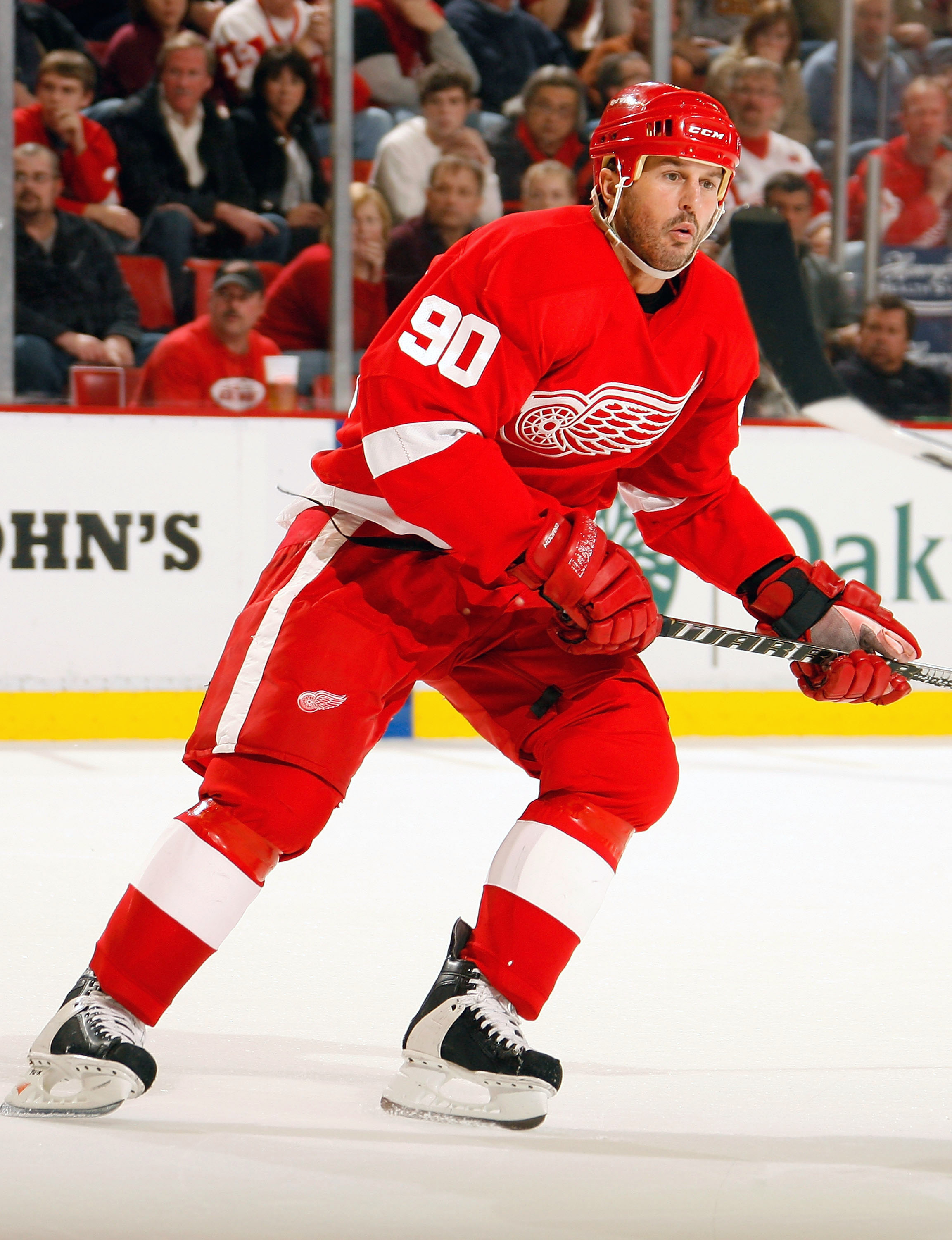 DETROIT, MI - NOVEMBER 21:  Mike Modano #90 of the Detroit Red Wings skates against the Calgary Flames during their NHL game at Joe Louis Arena on November 21, 2010 in Detroit, Michigan.(Photo by Dave Sandford/Getty Images)