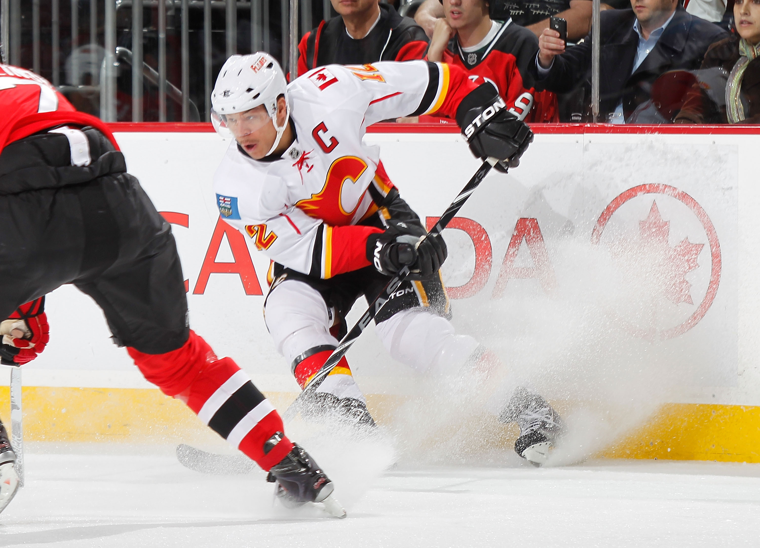 NEWARK, NJ - NOVEMBER 24:  Jarome Iginla #12 of the Calgary Flames skates during a hockey game against the New Jersey Devils at the Prudential Center on November 24, 2010 in Newark, New Jersey.  (Photo by Paul Bereswill/Getty Images)