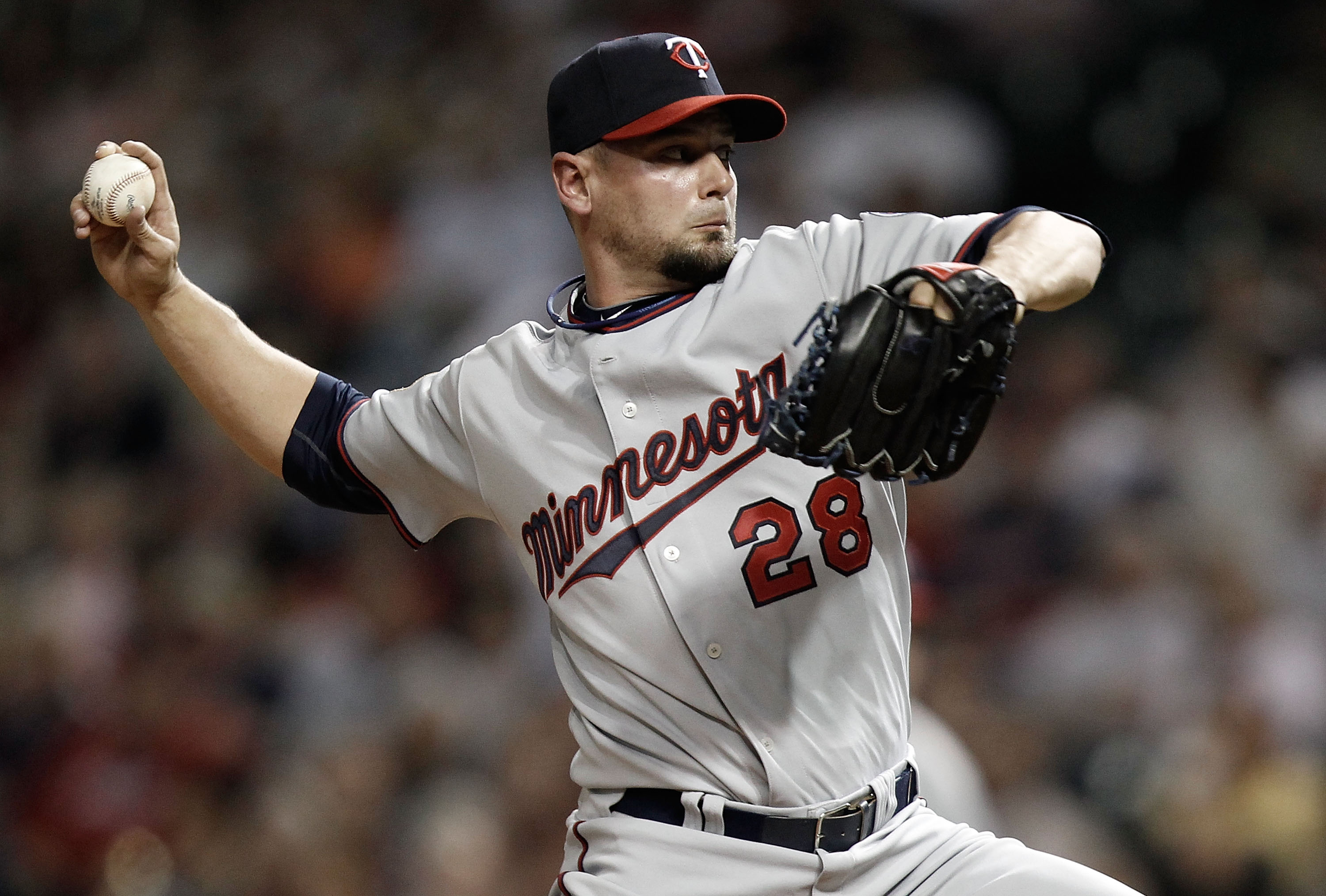 CLEVELAND, OH- APRIL 30: Jesse Crain #28 of the Minnesota Twins pitches against the Cleveland Indians during the game on April 30, 2010 at Progressive Field in Cleveland, Ohio.  (Photo by Jared Wickerham/Getty Images)
