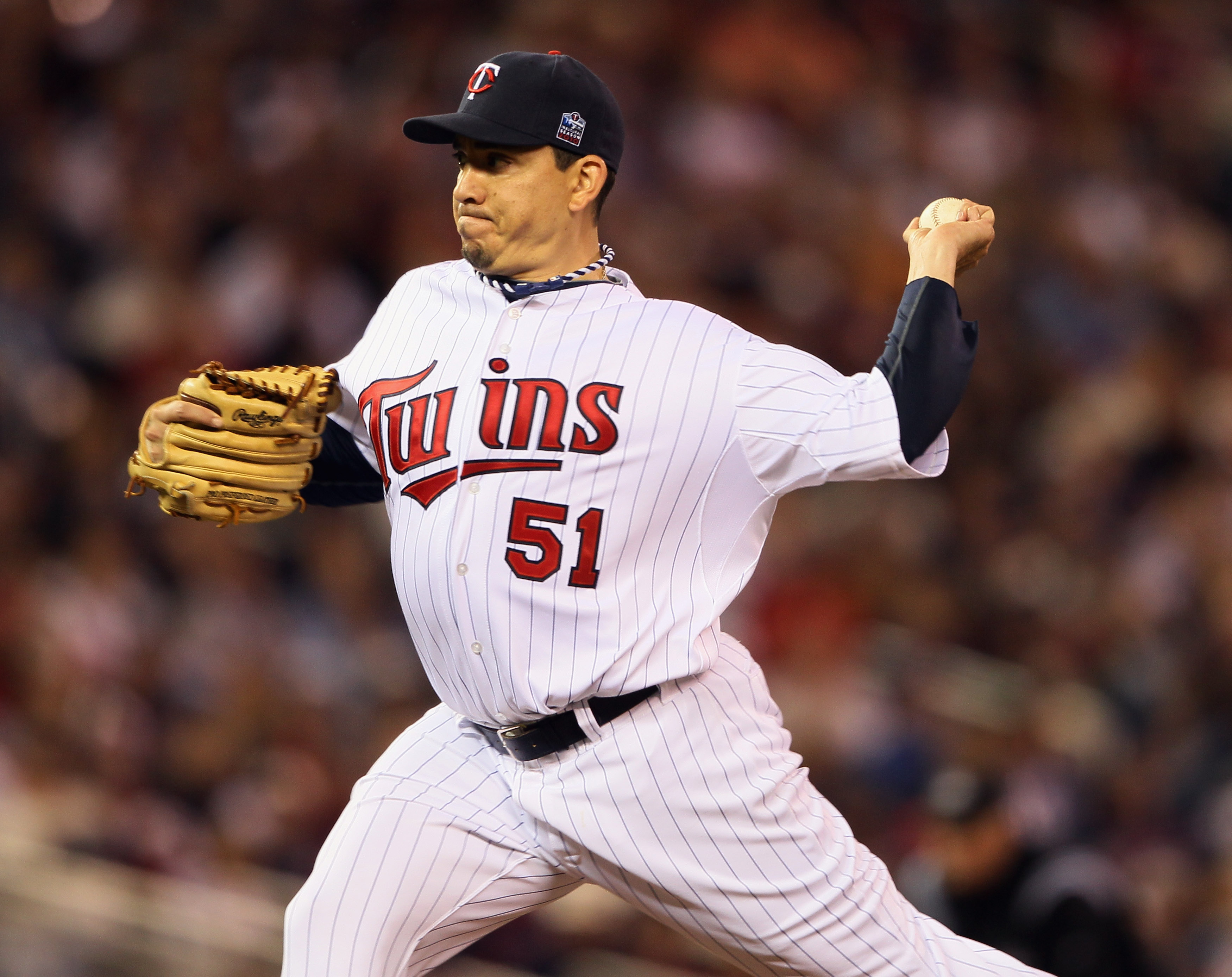 MINNEAPOLIS - OCTOBER 06:  Brian Fuentes #51 of the Minnesota Twins delivers a pitch against the New York Yankees during game one of the ALDS on October 6, 2010 at Target Field in Minneapolis, Minnesota. The Yankees defeated the Twins 6-4.  (Photo by Elsa