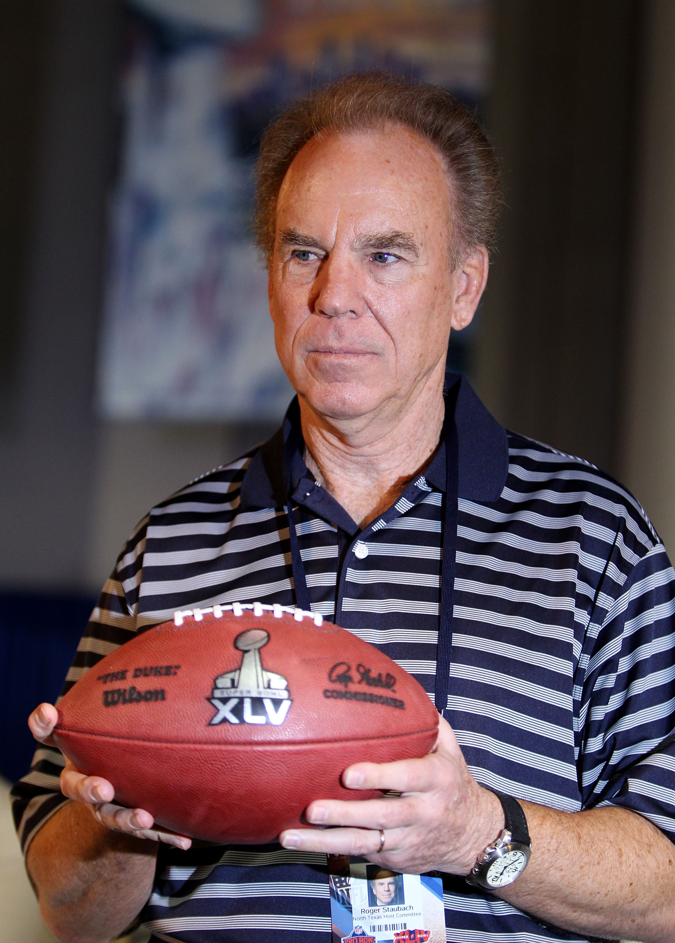 FORT LAUDERDALE, FL - FEBRUARY 04:  Roger Staubach, former NFL quarterback, holds a football with the new Super Bowl logo during a press conference held at the Fort Lauderdale Convention Center as part of media week for Super Bowl XLIV on February 4, 2010