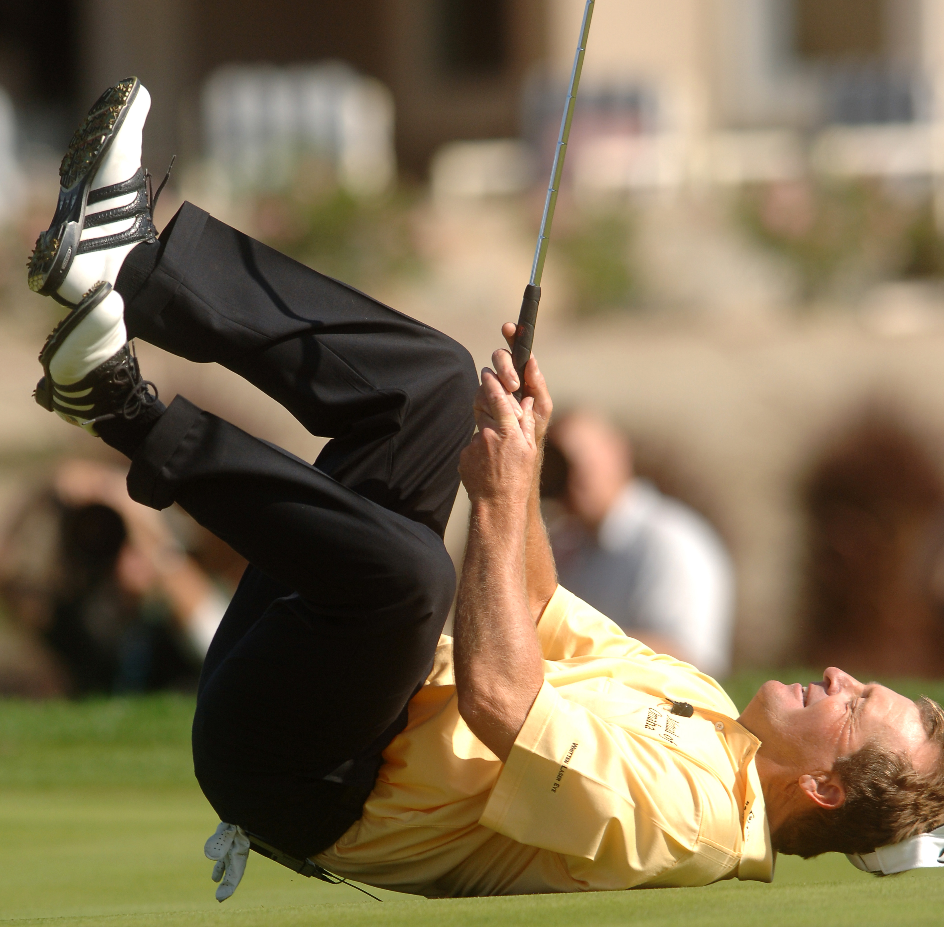UNITED STATES - NOVEMBER 26:  Fred Funk falls to the ground after missing a birdie attempt on the seventh green the Merrill Lynch Skins Game at Trilogy Golf Club at La Quinta in La Quinta, California November 26, 2005.  (Photo by Steve Grayson/Getty Image