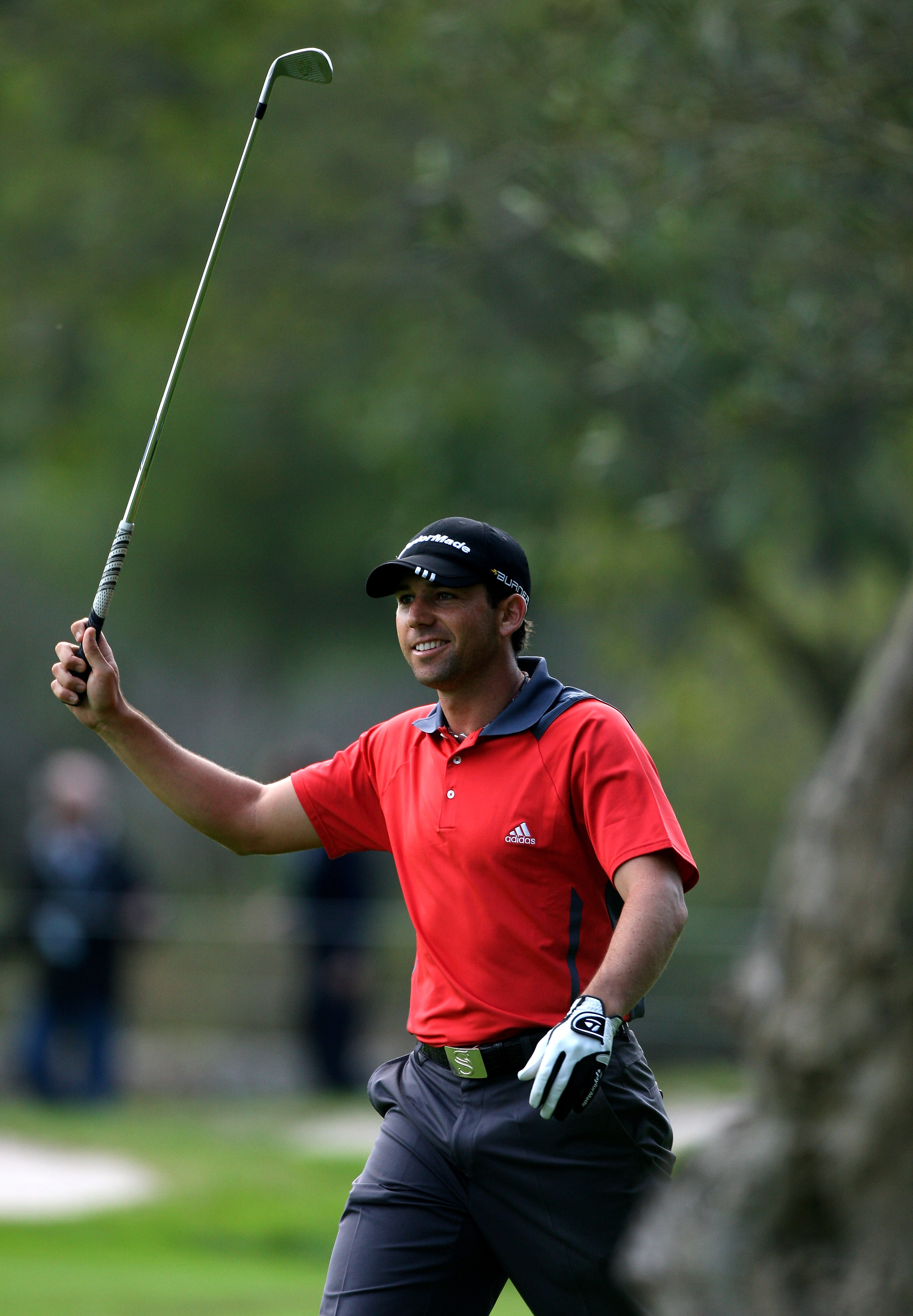 CASTELLO, SPAIN - OCTOBER 24:  Sergio Garcia of Spain looks happy after playing his shot through the trees on the 18th hole during the second round of the Castello Masters Costa Azahar at the Club de Campo del Mediterraneo on October 24, 2008 in Castello,