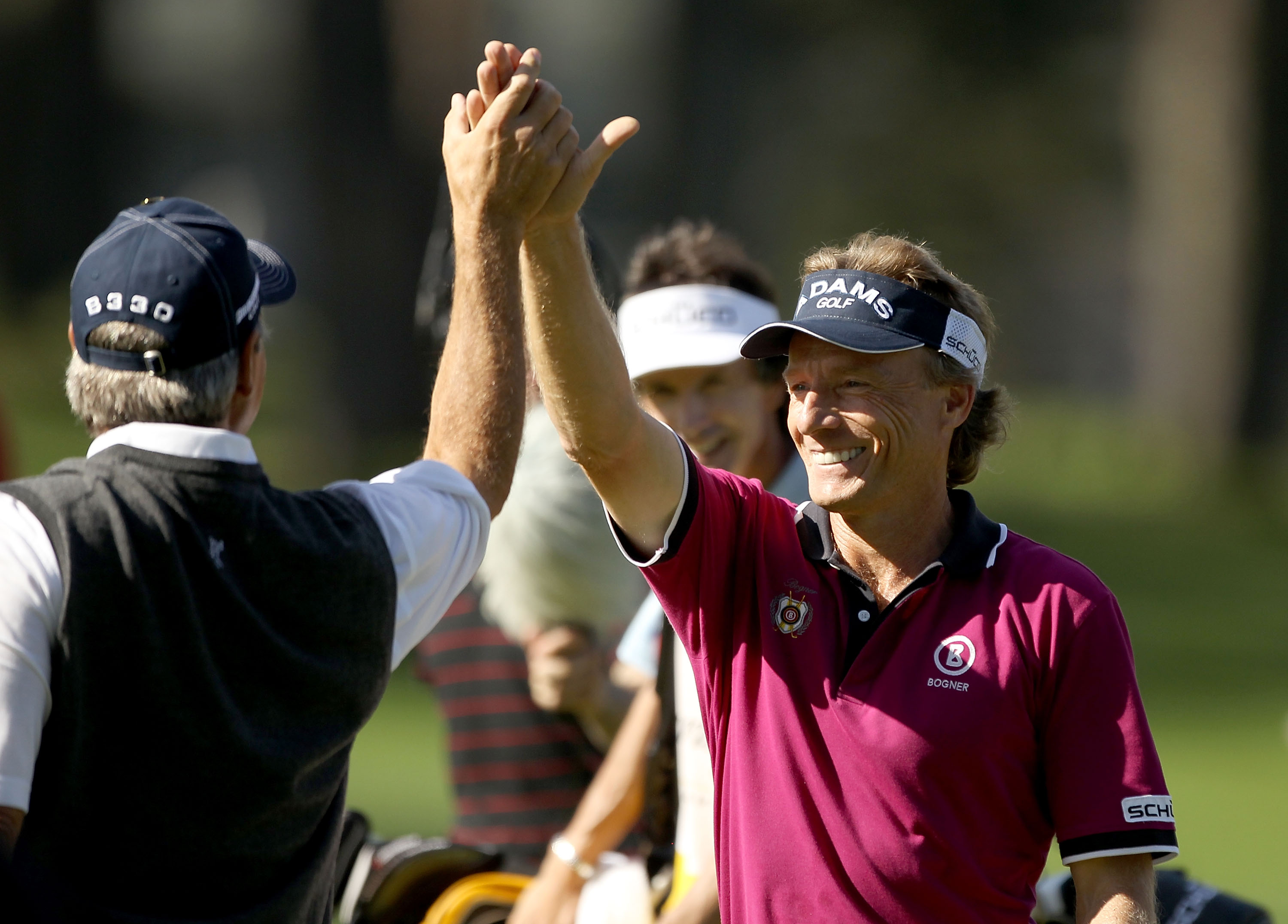 SAN FRANCISCO - NOVEMBER 04:  Bernhard Langer of Germany high fives Fred Couples of the USA after hitting a hole-in-one on the third hole of round 1 of the Charles Schwab Cup Championship at Harding Park Golf Course on November 4, 2010 in San Francisco, C