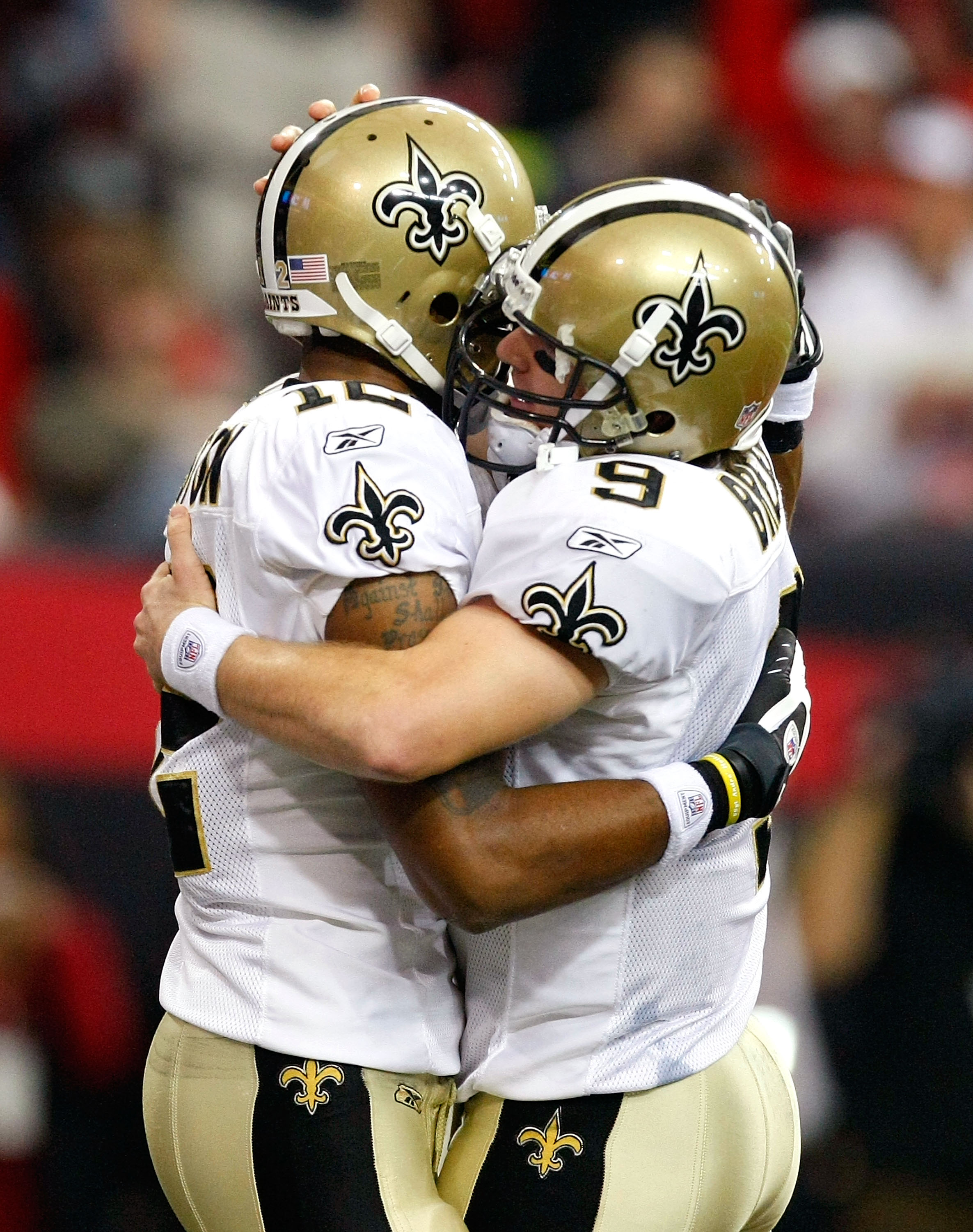 ATLANTA - DECEMBER 13:  Marques Colston #12 and quarterback Drew Brees #9 (R) of the New Orleans Saints celebrate Colston's 3-yard touchdown reception in the second quarter against the Atlanta Falcons at Georgia Dome on December 13, 2009 in Atlanta, Georg