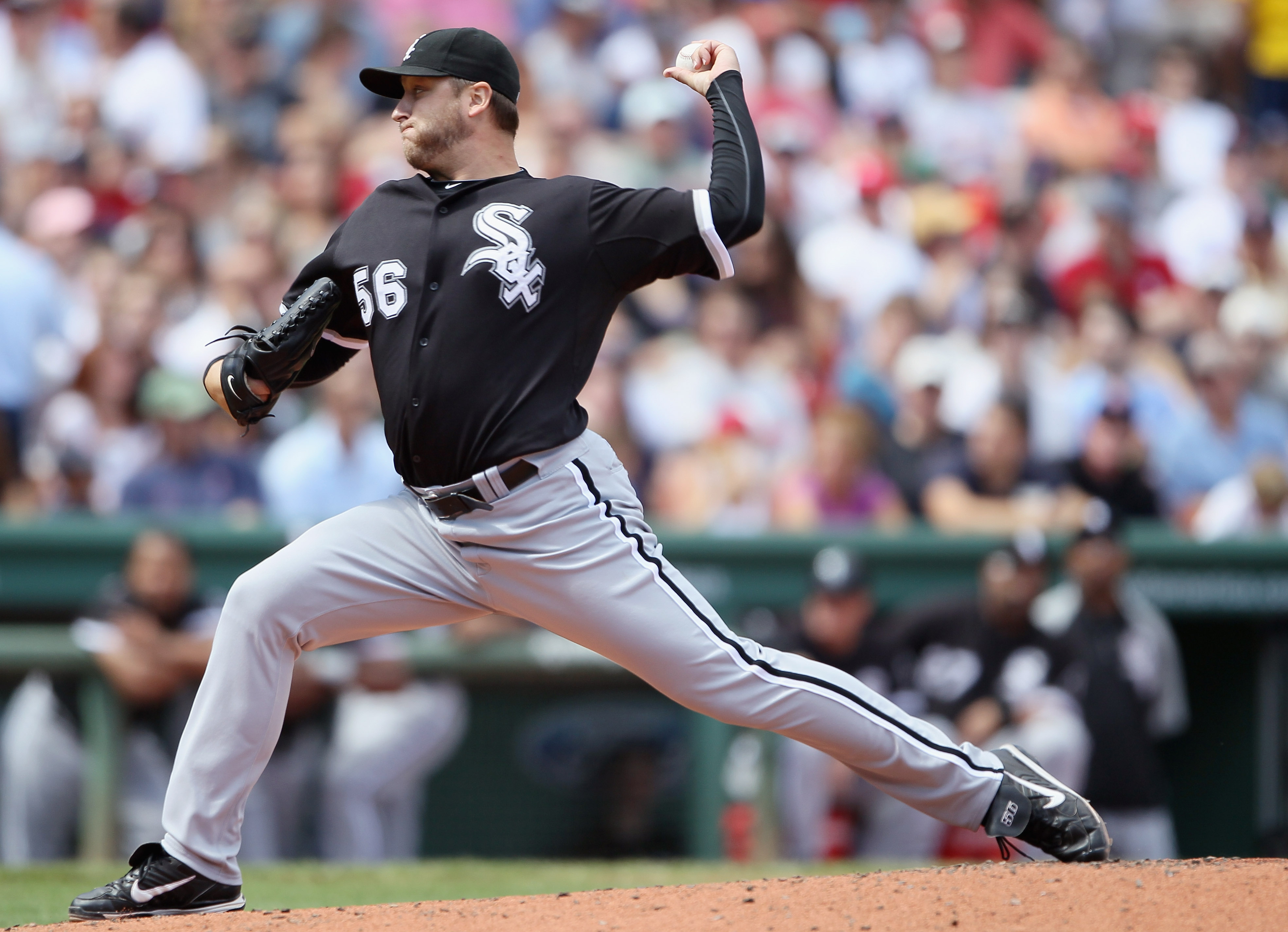 BOSTON - SEPTEMBER 05:  Mark Buehrle #56 of the Chicago White Sox delivers a pitch in the first inning against the Boston Red Sox on September 5, 2010 at Fenway Park in Boston, Massachusetts.  (Photo by Elsa/Getty Images)