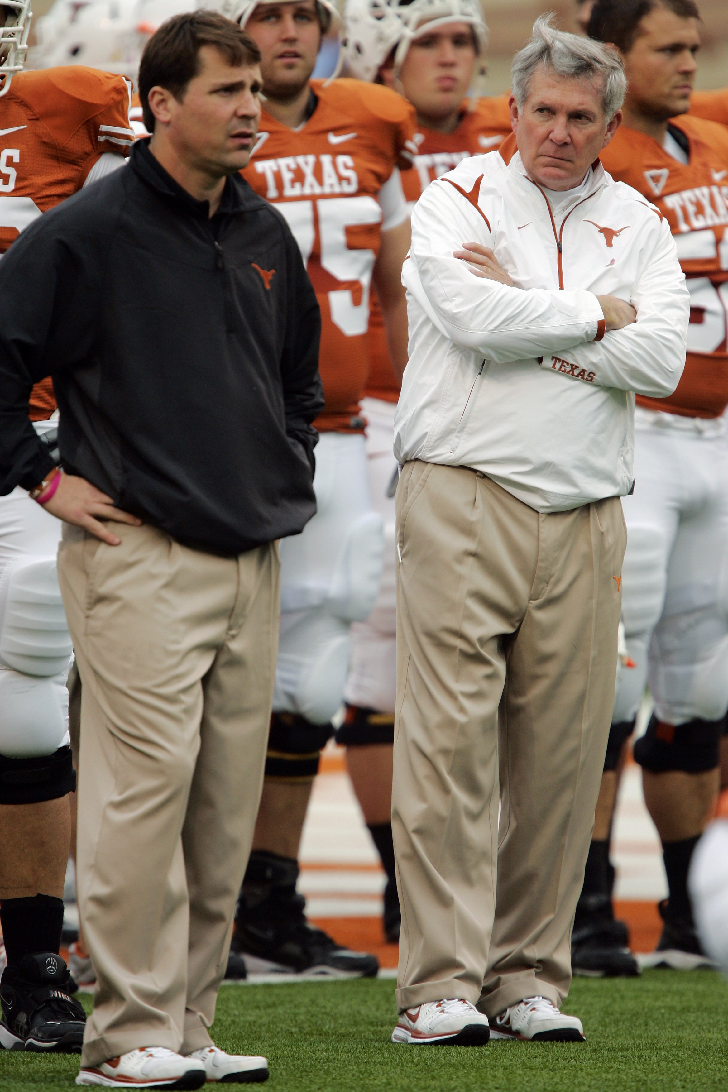 AUSTIN, TX - OCTOBER 10:  Defensive coordinator Will Muschamp and head coach Mack Brown of the Texas Longhorns lead their team in pregame drills before playing the Colorado Buffaloes  on October 10, 2009 at Darrell K Royal-Texas Memorial Stadium in Austin