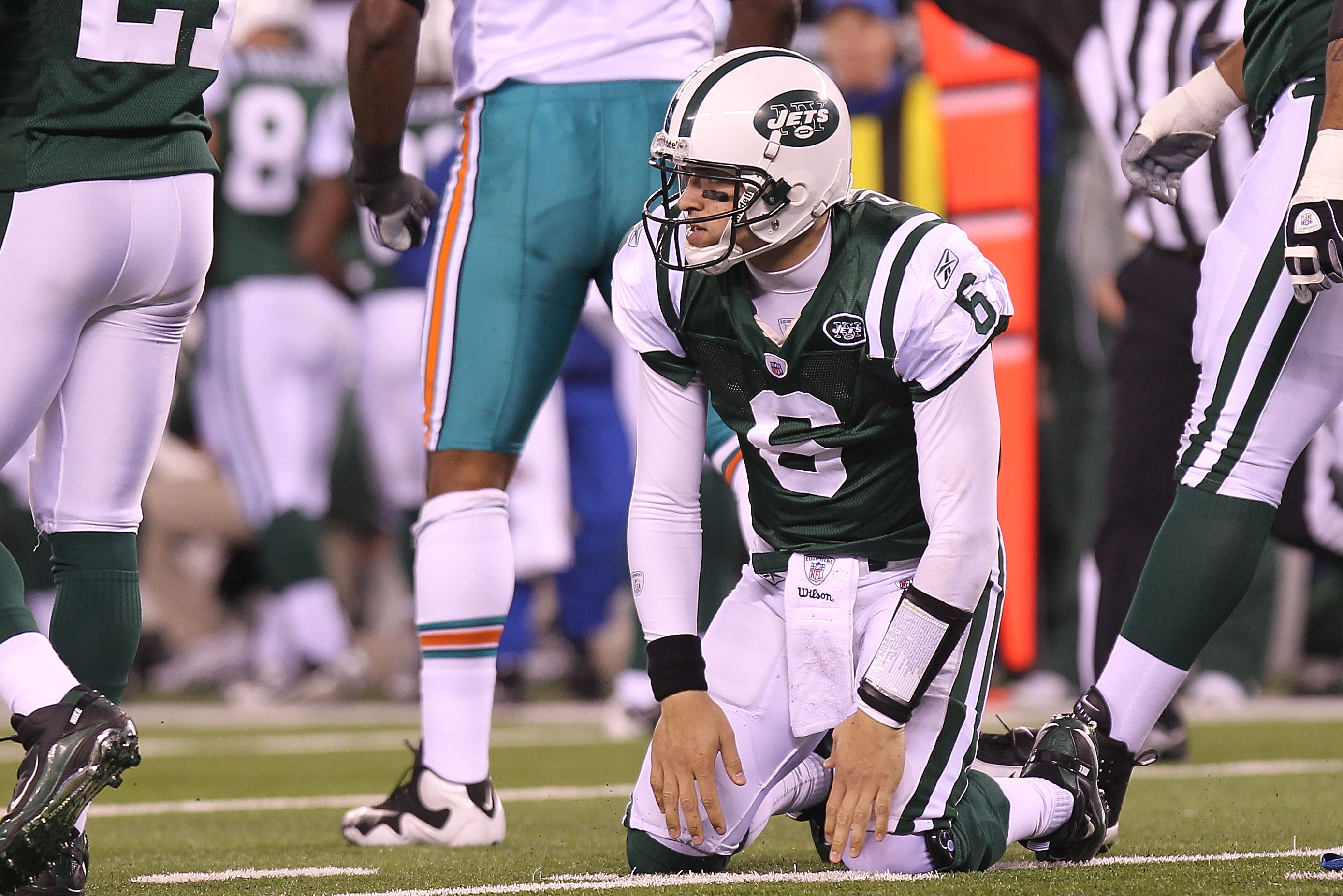 EAST RUTHERFORD, NJ - DECEMBER 12:  Mark Sanchez #6 of the New York Jets picks himself up after an incomplete pass against the Miami Dolphins at New Meadowlands Stadium on December 12, 2010 in East Rutherford, New Jersey.  (Photo by Nick Laham/Getty Image