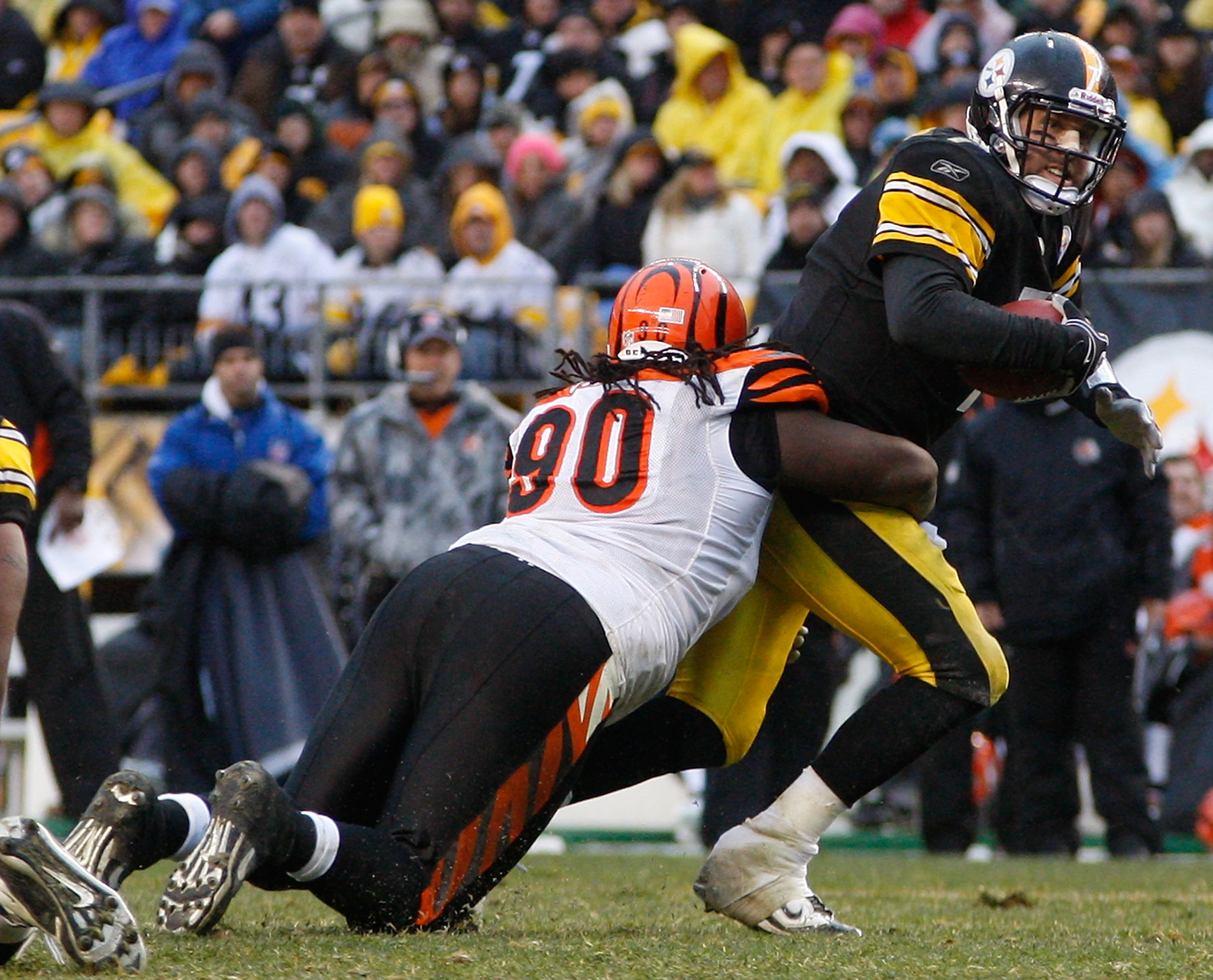 PITTSBURGH - DECEMBER 12:  Ben Roethlisberger #7 of the Pittsburgh Steelers is sacked by Pat Sims #90 of the Cincinnati Bengals during the game on December 12, 2010 at Heinz Field in Pittsburgh, Pennsylvania.  (Photo by Jared Wickerham/Getty Images)