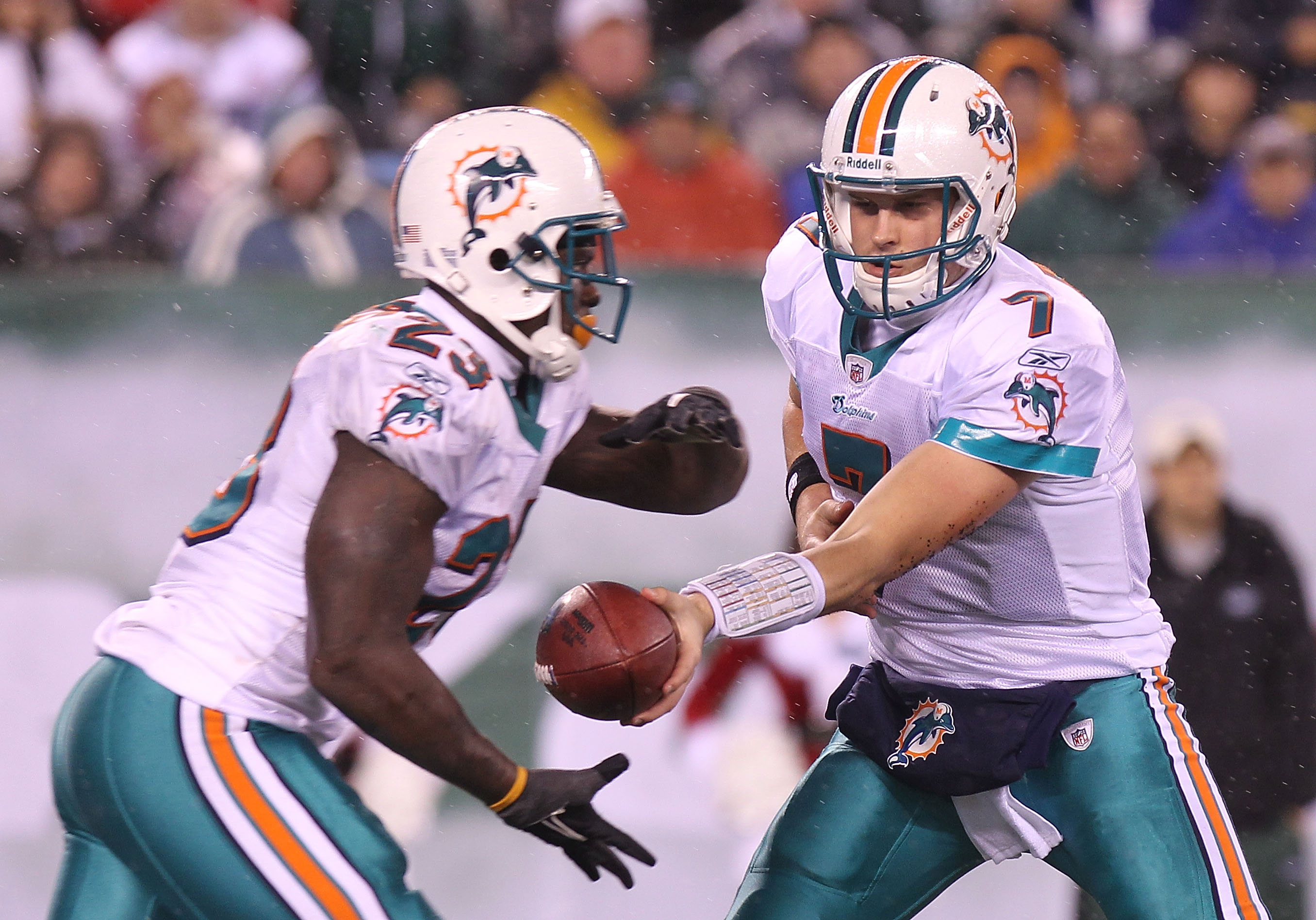 EAST RUTHERFORD, NJ - DECEMBER 12: Chad Henne #7 of the Miami Dolphins hands the ball off to  Ronnie Brown #23 against the New York Jets at New Meadowlands Stadium on December 12, 2010 in East Rutherford, New Jersey.  (Photo by Nick Laham/Getty Images)