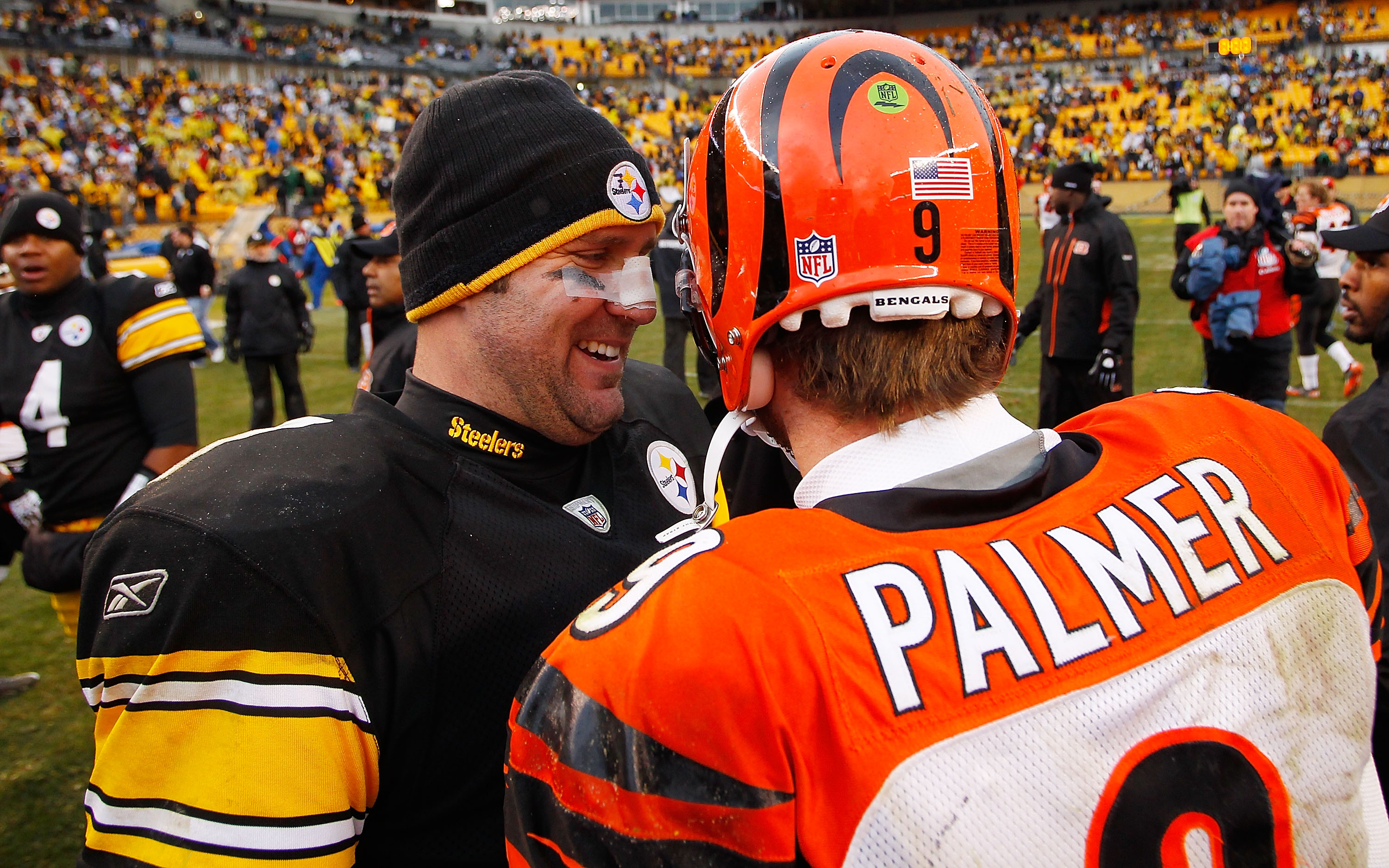 PITTSBURGH - DECEMBER 12:  Ben Roethlisberger #7 of the Pittsburgh Steelers laughs with Carson Palmer #9 of the Cincinnati Bengals following the game on December 12, 2010 at Heinz Field in Pittsburgh, Pennsylvania.  (Photo by Jared Wickerham/Getty Images)