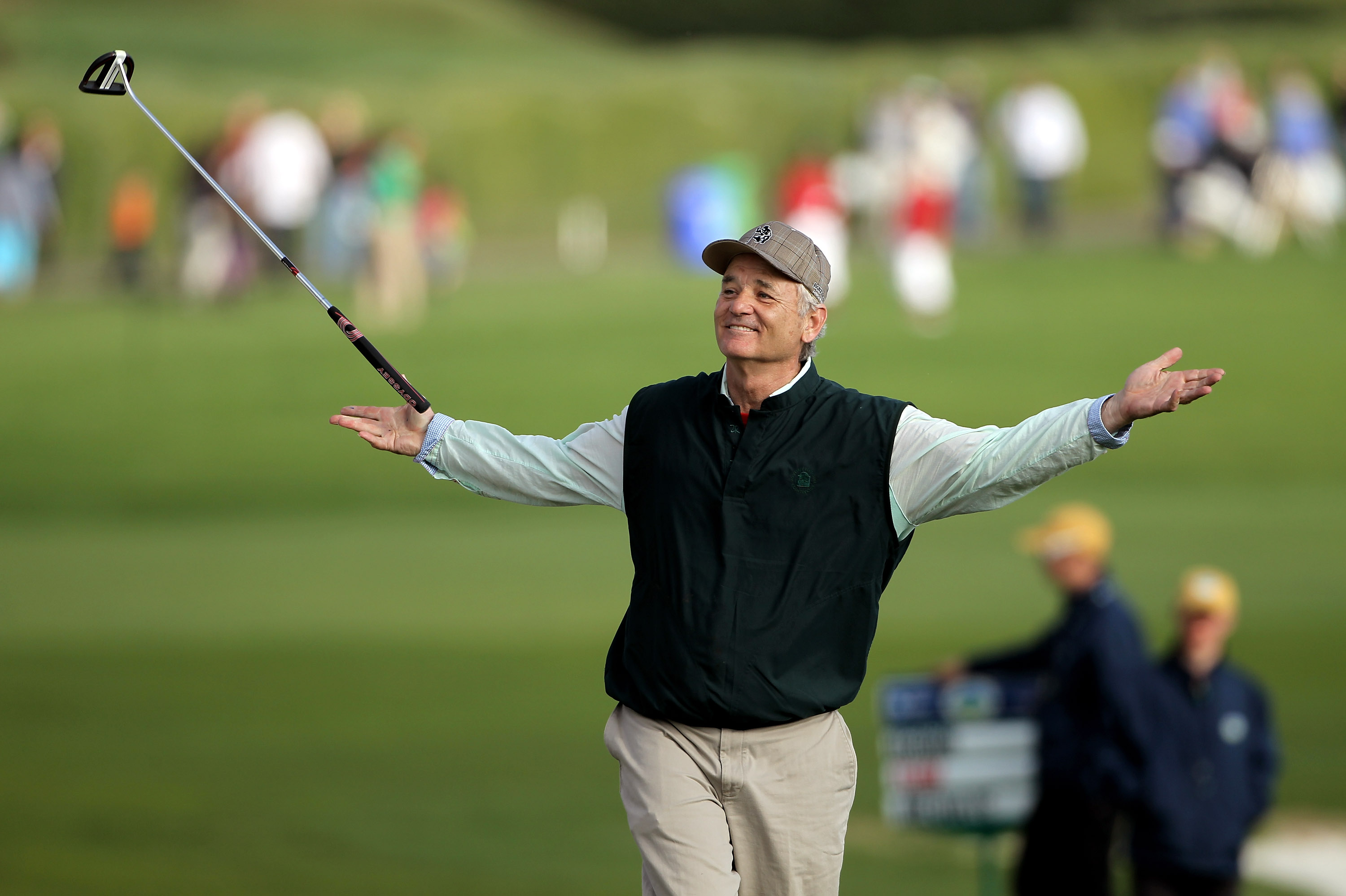 PEBBLE BEACH, CA - FEBRUARY 13:  Actor Bill Murray tosses his club in the air after sinking a putt on the 18th hole during round three of the AT&T Pebble Beach National Pro-Am at Pebble Beach Golf Links on February 13, 2010 in Pebble Beach, California.  (