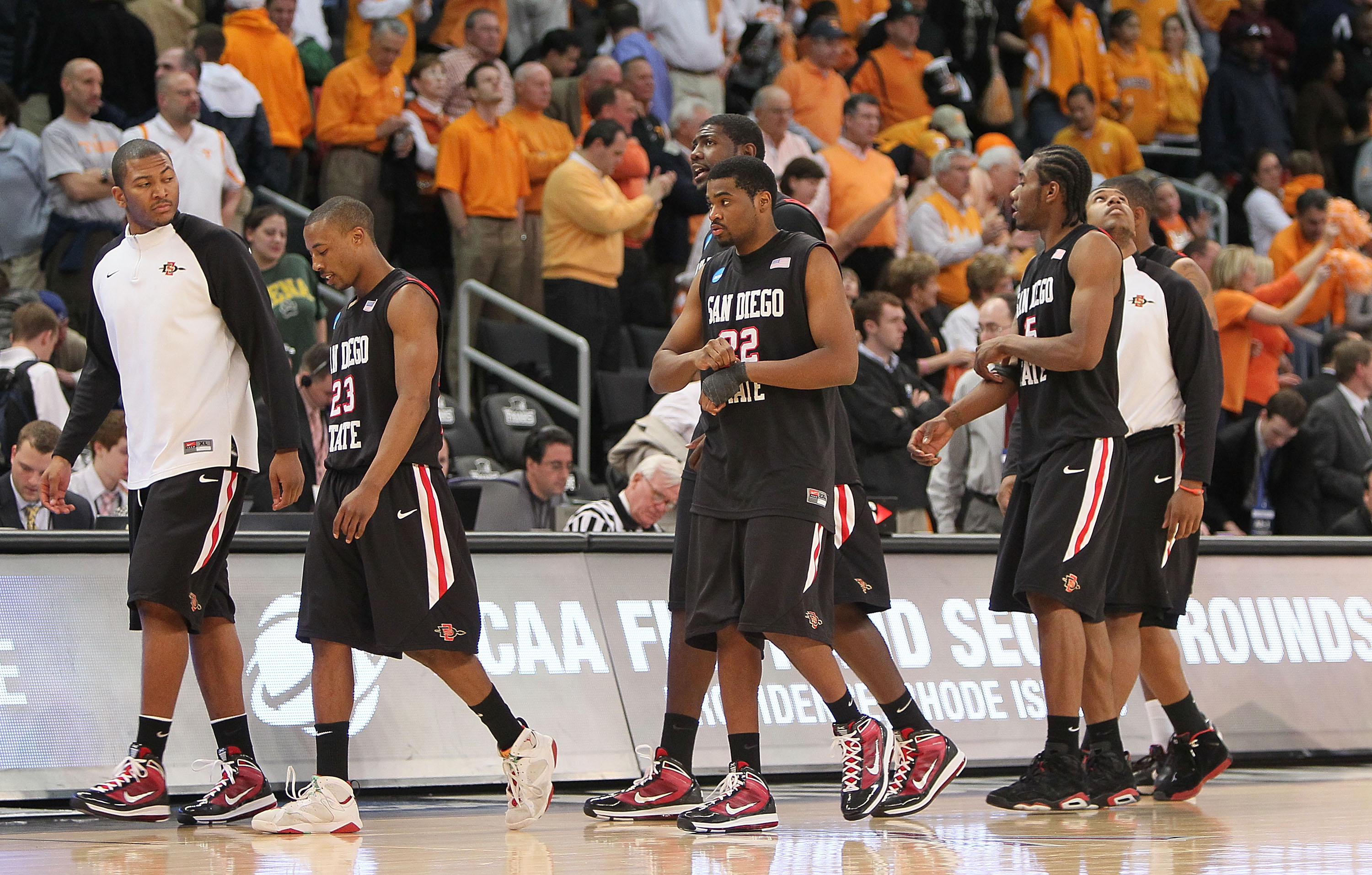 PROVIDENCE, RI - MARCH 19:  Members of the San Diego State Aztecs leave the court after a 62-59 loss to the Tennessee Volunteers during the first round of the 2010 NCAA men's basketball tournament at Dunkin' Donuts Center on March 19, 2010 in Providence,