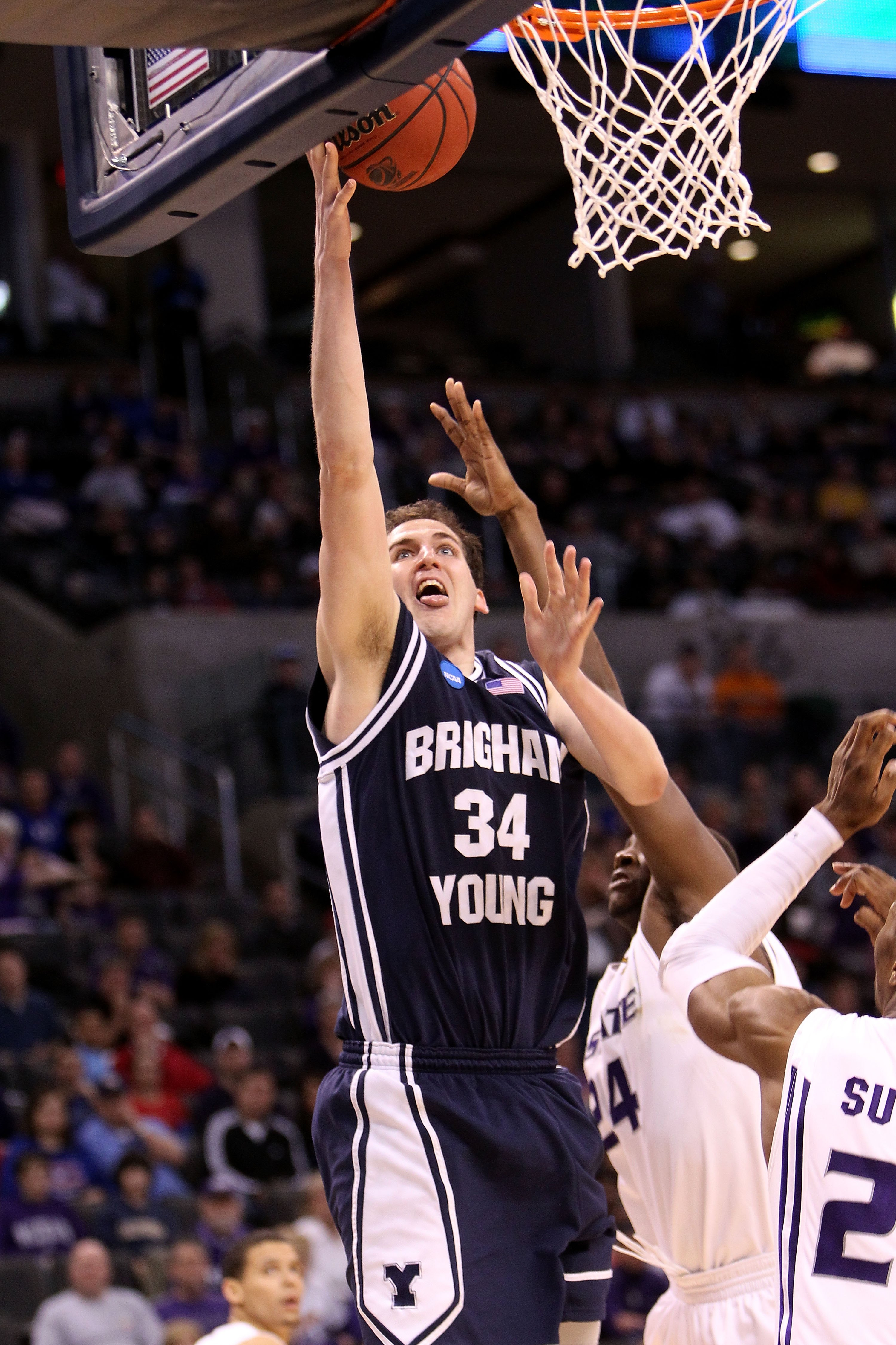 OKLAHOMA CITY - MARCH 20:  Noah Hartsock #34 of the Brigham Young Cougars attempts a shot against the Kansas State Wildcats during the second round of the 2010 NCAA men's basketball tournament at Ford Center on March 20, 2010 in Oklahoma City, Oklahoma.