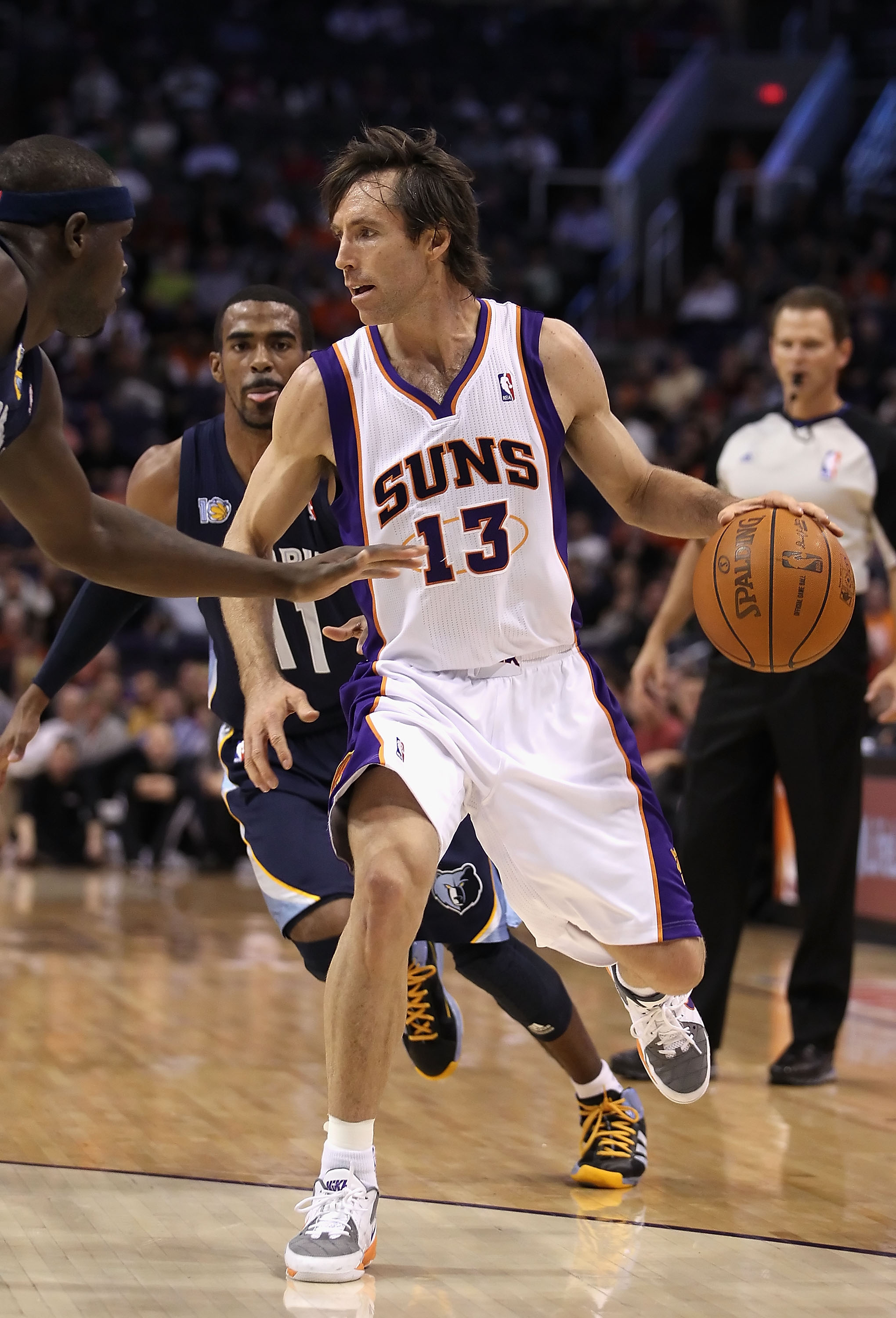 PHOENIX - DECEMBER 08:  Steve Nash #13 of the Phoenix Suns hanldes the ball during the NBA game against the Memphis Grizzlies at US Airways Center on December 8, 2010 in Phoenix, Arizona. NOTE TO USER: User expressly acknowledges and agrees that, by downl