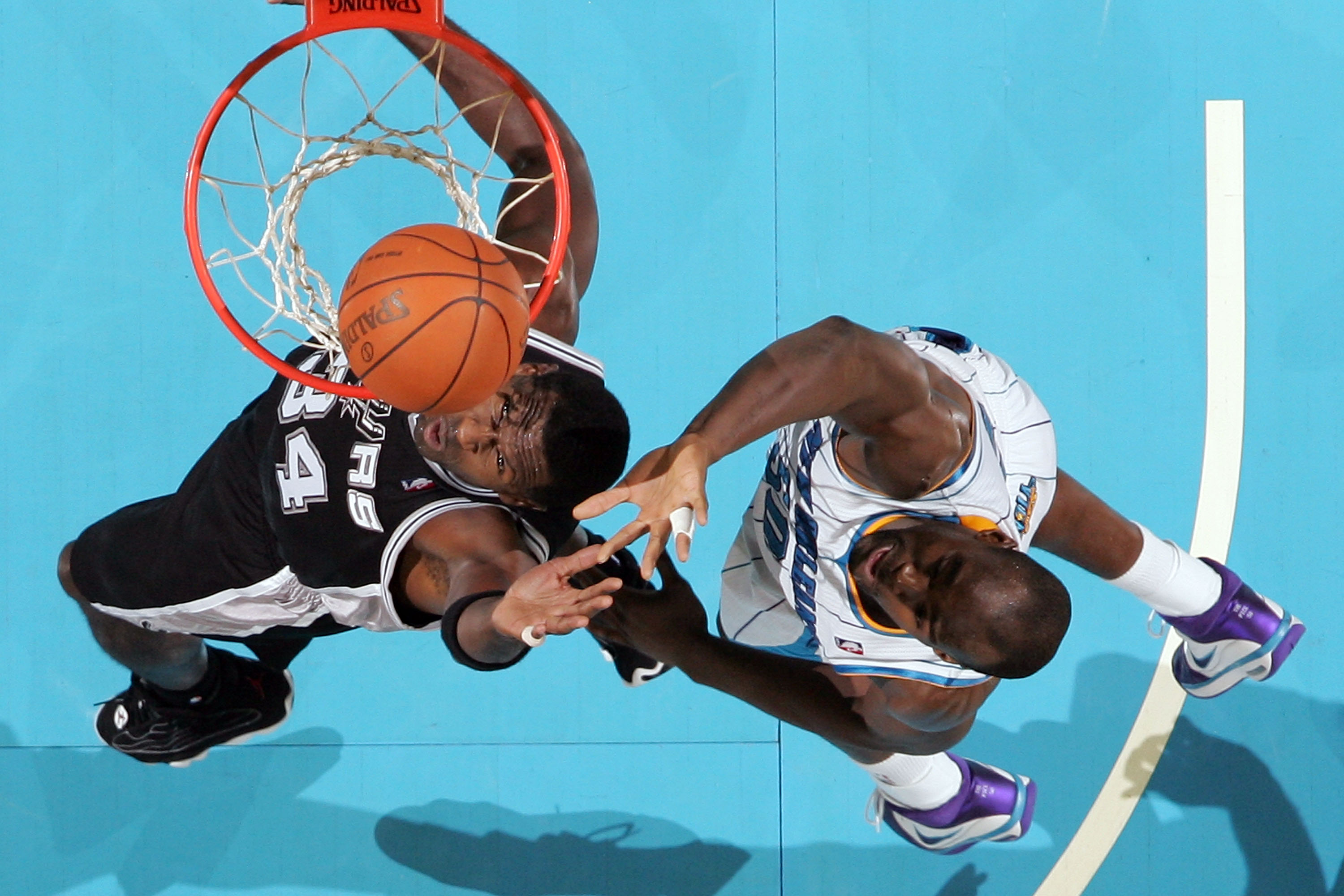 NEW ORLEANS - NOVEMBER 28: Antonio McDyess #34 of the San Antonio Spurs shoots the ball over Emeka Okafor #50 of the New Orleans Hornets at the New Orleans Arena on November 28, 2010 in New Orleans, Louisiana.  The Spurs defeated the Hornets 109-95.  NOTE