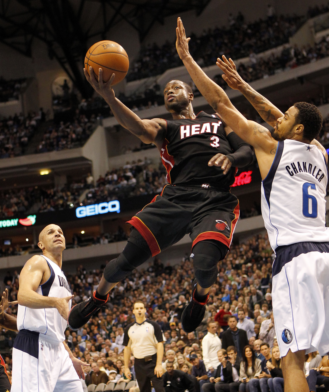 32e7d0c027a DALLAS - NOVEMBER 27  Dwyane Wade  3 of the Miami Heat shoots over Tyson