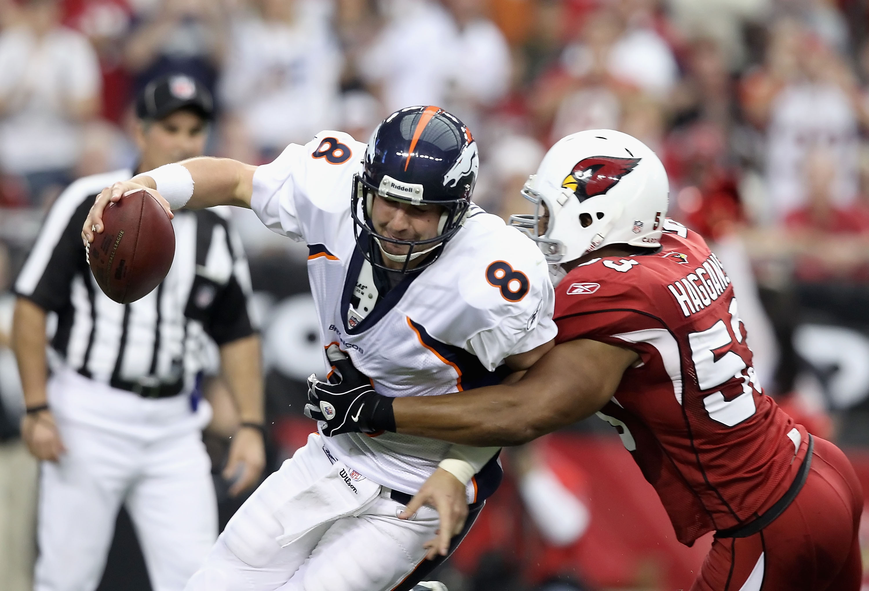 GLENDALE, AZ - DECEMBER 12:  Quarterback Kyle Orton #8 of the Denver Broncos is sacked by Clark Haggans #53 of the Arizona Cardinals during the NFL game at the University of Phoenix Stadium on December 12, 2010 in Glendale, Arizona.  The Cardinals defeate